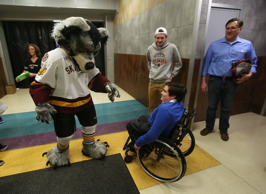 Skates, the Chicago Wolves' mascot, congratulates St. Viator High School senior Tim Gruensfelder after he received the Breslin Memorial Scholarship from the Wolves on April 6 at Allstate Arena in Rosemont. The award is given to an outstanding student who overcomes a hardship. Tim was diagnosed with a rare brain tumor when he was four.