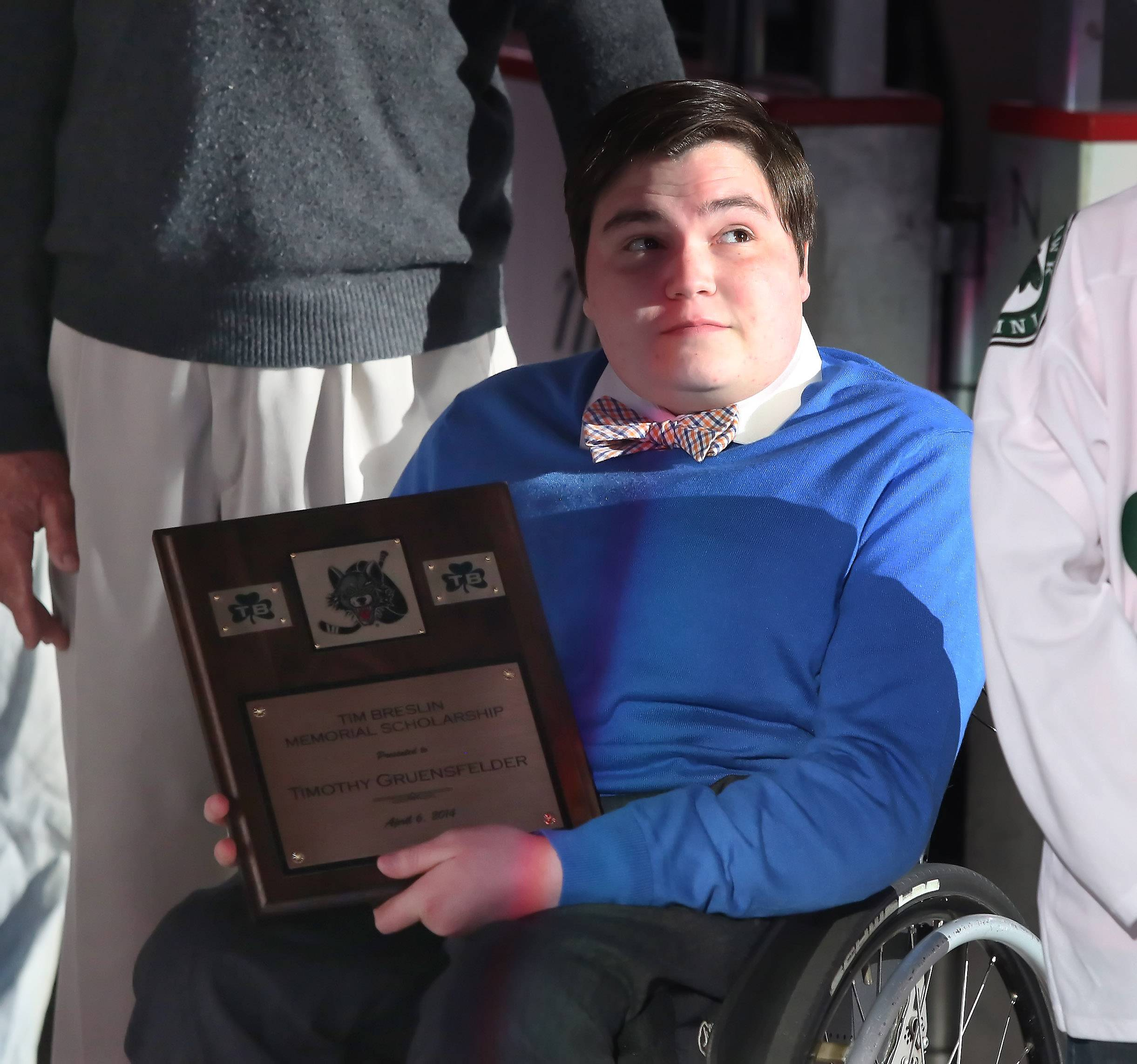 St. Viator student Tim Gruensfelder received the Tim Breslin Memorial Scholarship from the Chicago Wolves on April 6 at Allstate Arena in Rosemont. Tim was diagnosed with a rare brain tumor when he was 4, but has never let that stop him from accomplishing his goals.