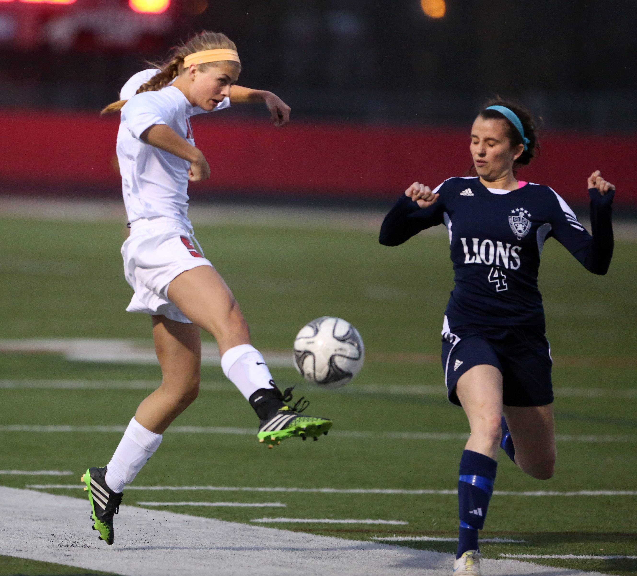 Barrington's Jackie Batliner passes the ball as St. Viator's Susie Moynihan cuts across the passing lane on Thursday in Barrington.
