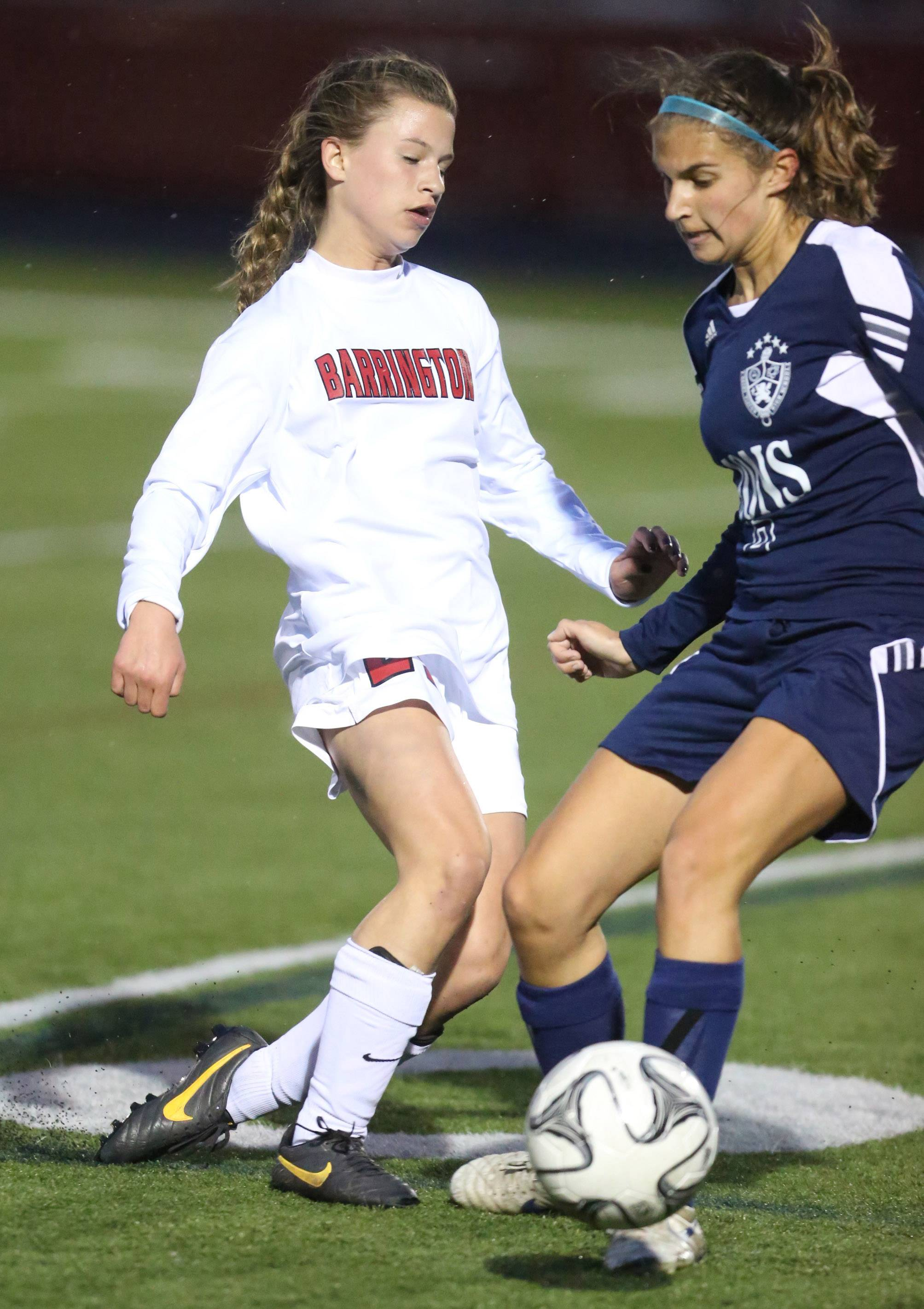 St. Viator's Emma Henry, right, looks to dibble past Barrington's Kayla Schutter on Thursday.