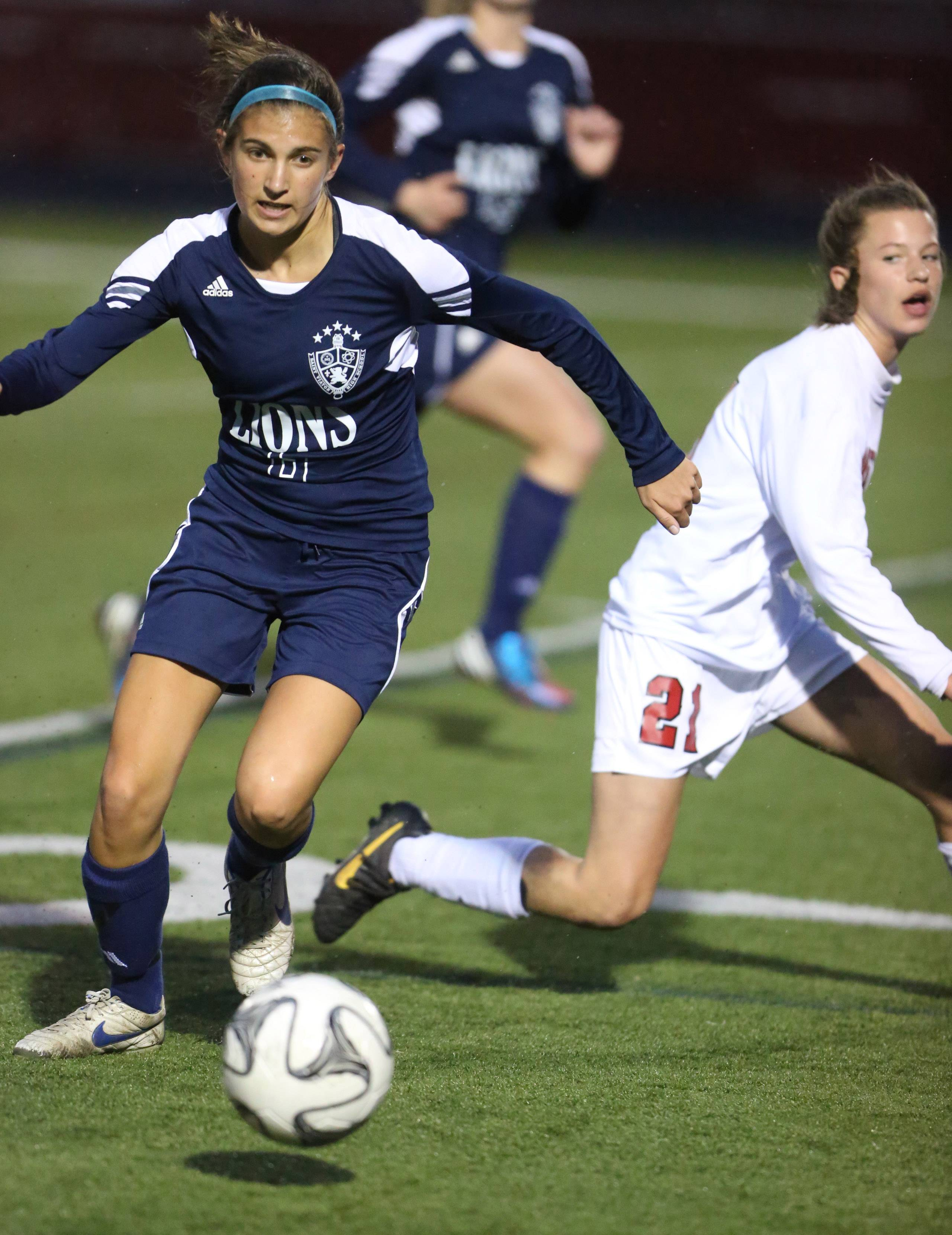 St. Viator's Emma Henry, left, passes the ball ahead of Barrington's Kayla Schutter on Thursday.