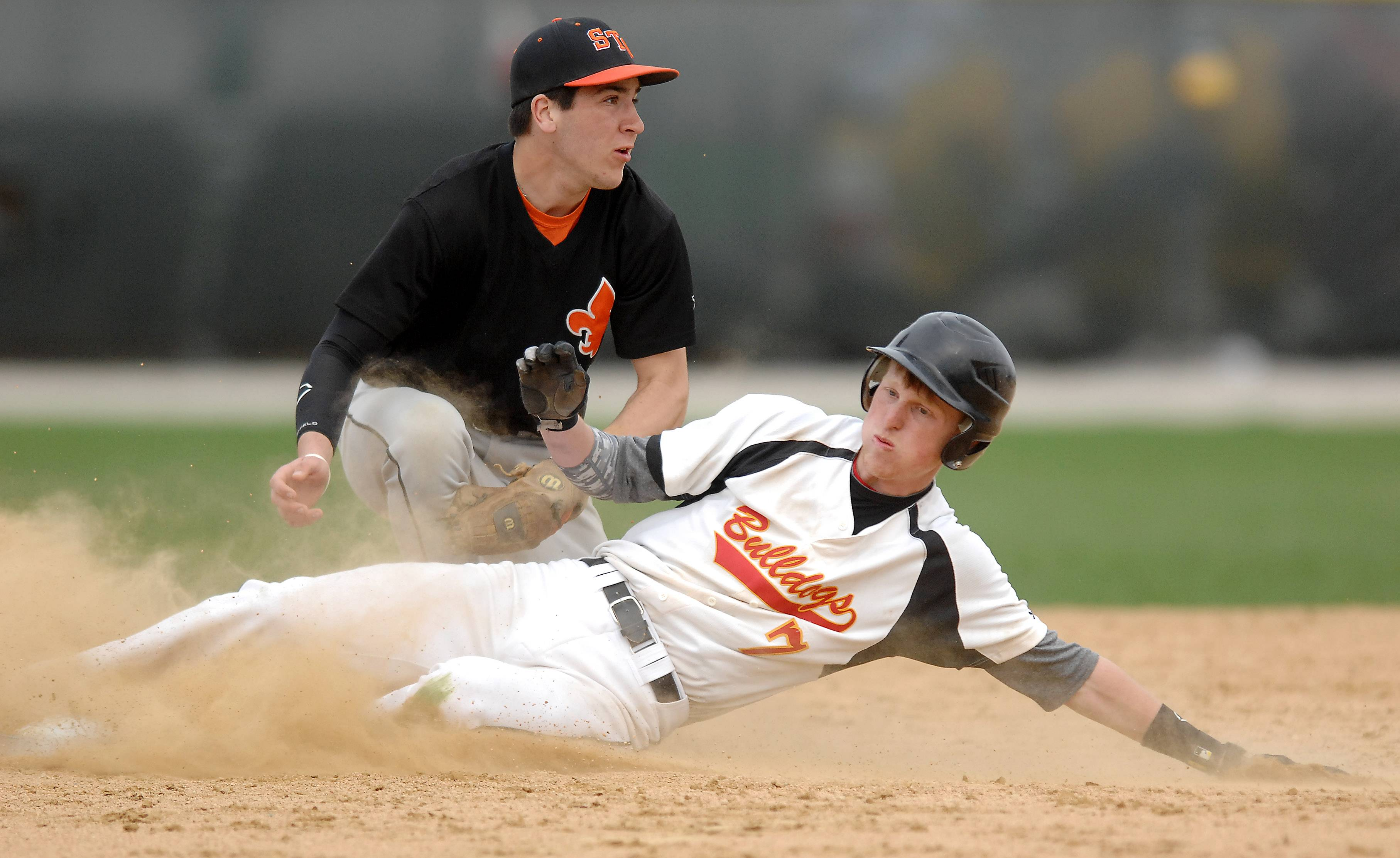 Batavia's Andrew Siegler (7) is tagged out by St. Charles East's Jake Asquini (7) while trying to stretch a single into a double during Thursday's game in Batavia.