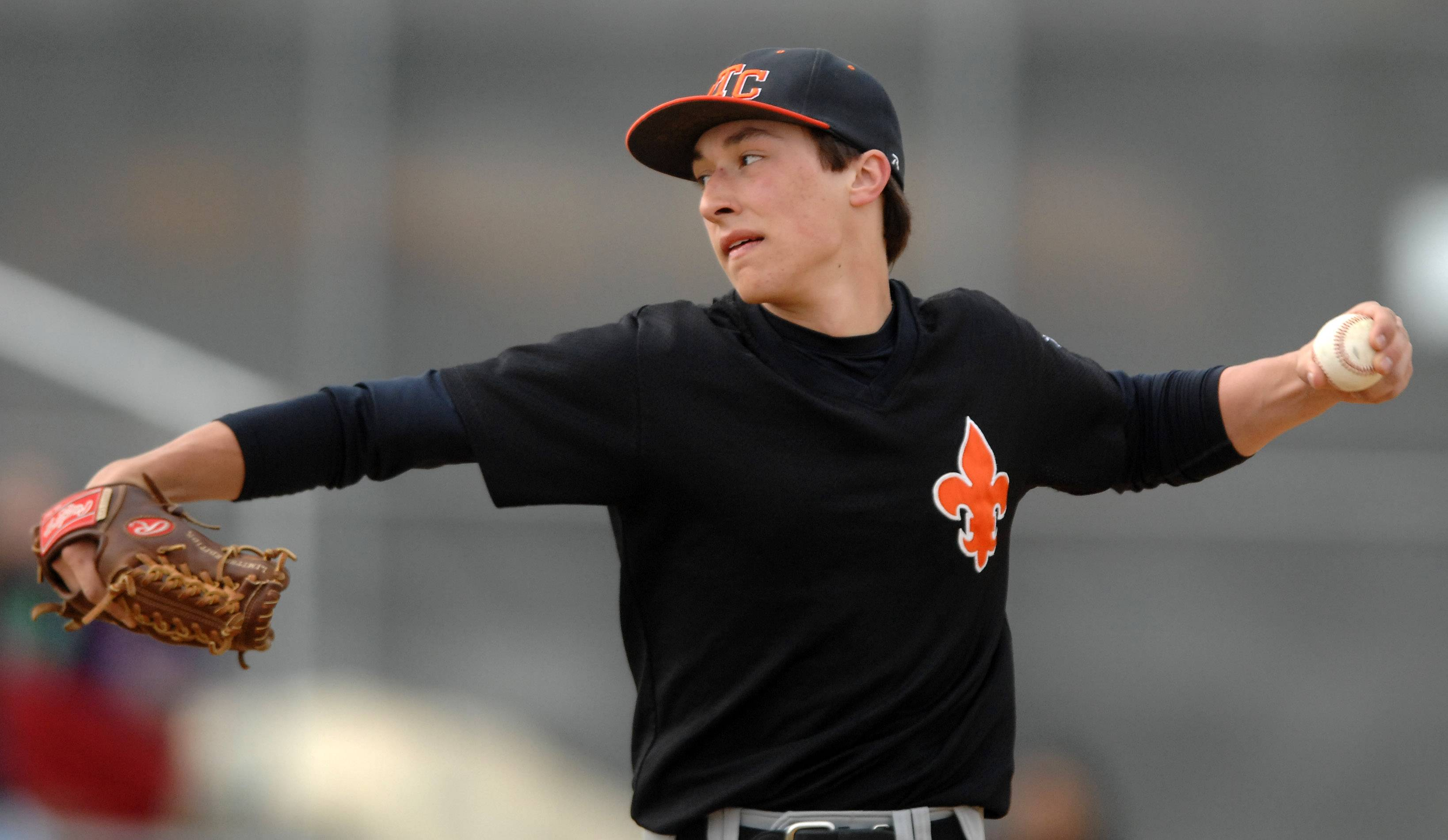 St. Charles East's Austin Regelbrugge (3) delivers a pitch against Batavia during Thursday's game in Batavia.