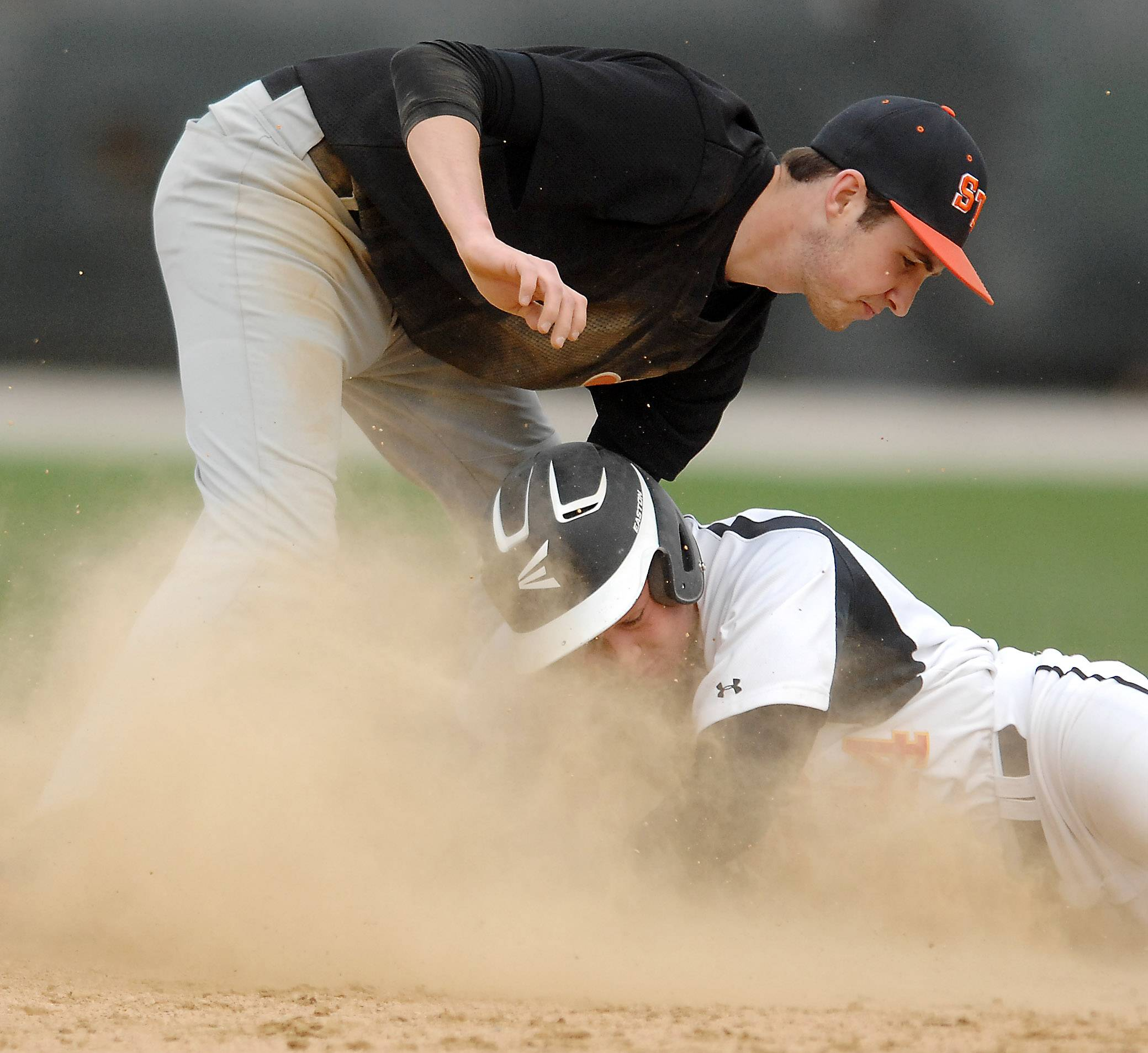 Batavia's Joe Gross (44) is tagged out by St. Charles East's Charles Alex Abate (4) at second during Thursday's game in Batavia.