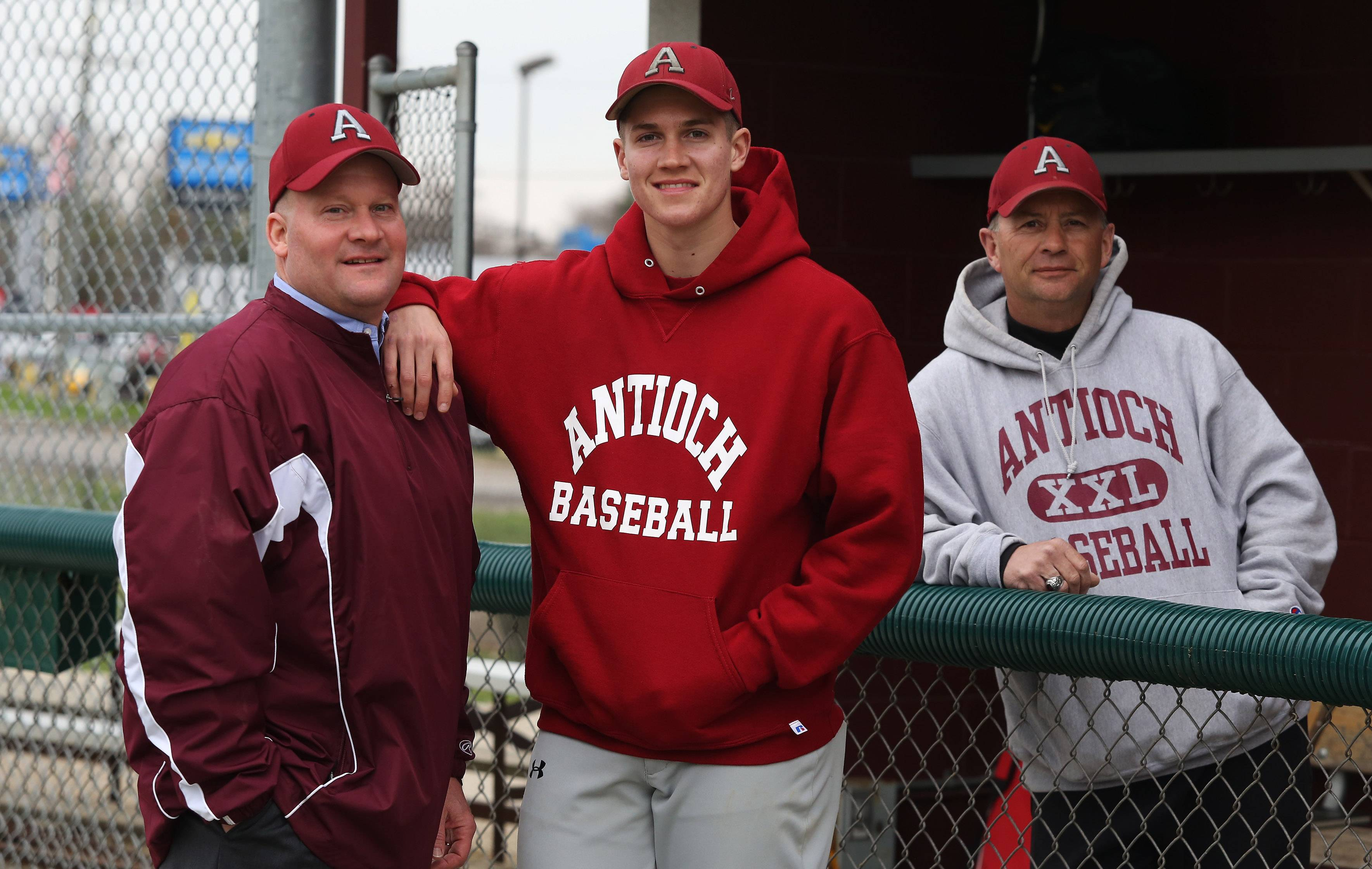 Craig Prather, left, with his son, Collin, who currently plays baseball at Antioch for coach Paul Petty. Craig also played baseball at Antioch, with Petty as his coach.