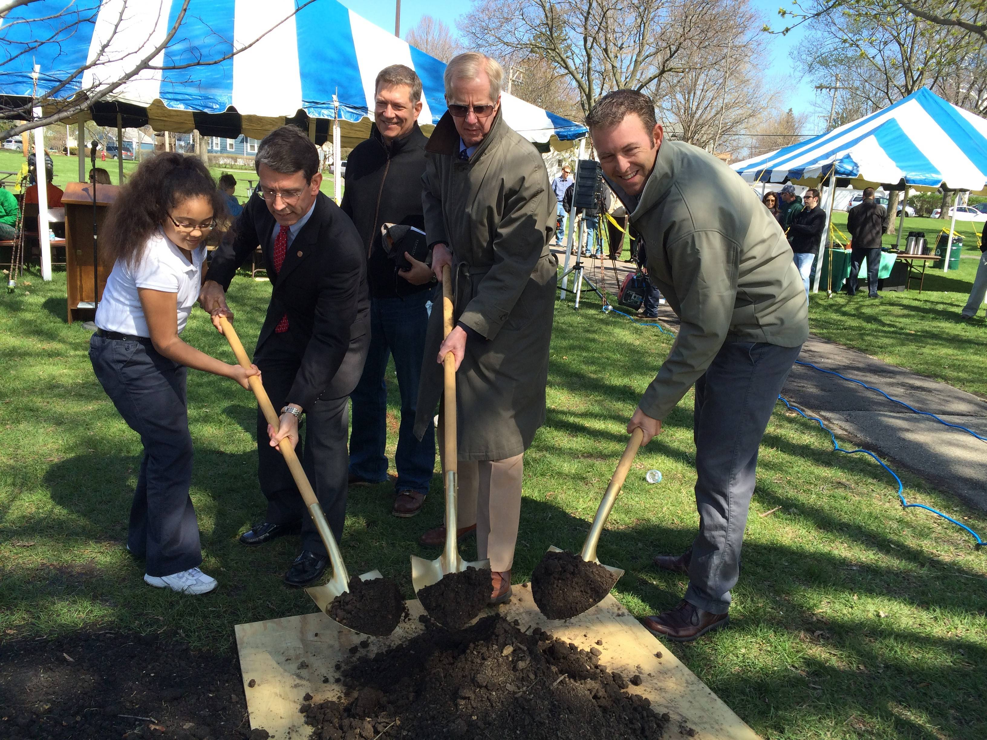 St. James Elementary student Clarise Chambers helps Mayor Tom Hayes, Trustee Mike Sidor, Village Manager Bill Dixon and park district Commissioner Tim Gelinas plant a new tree in Recreation Park for Arbor Day.