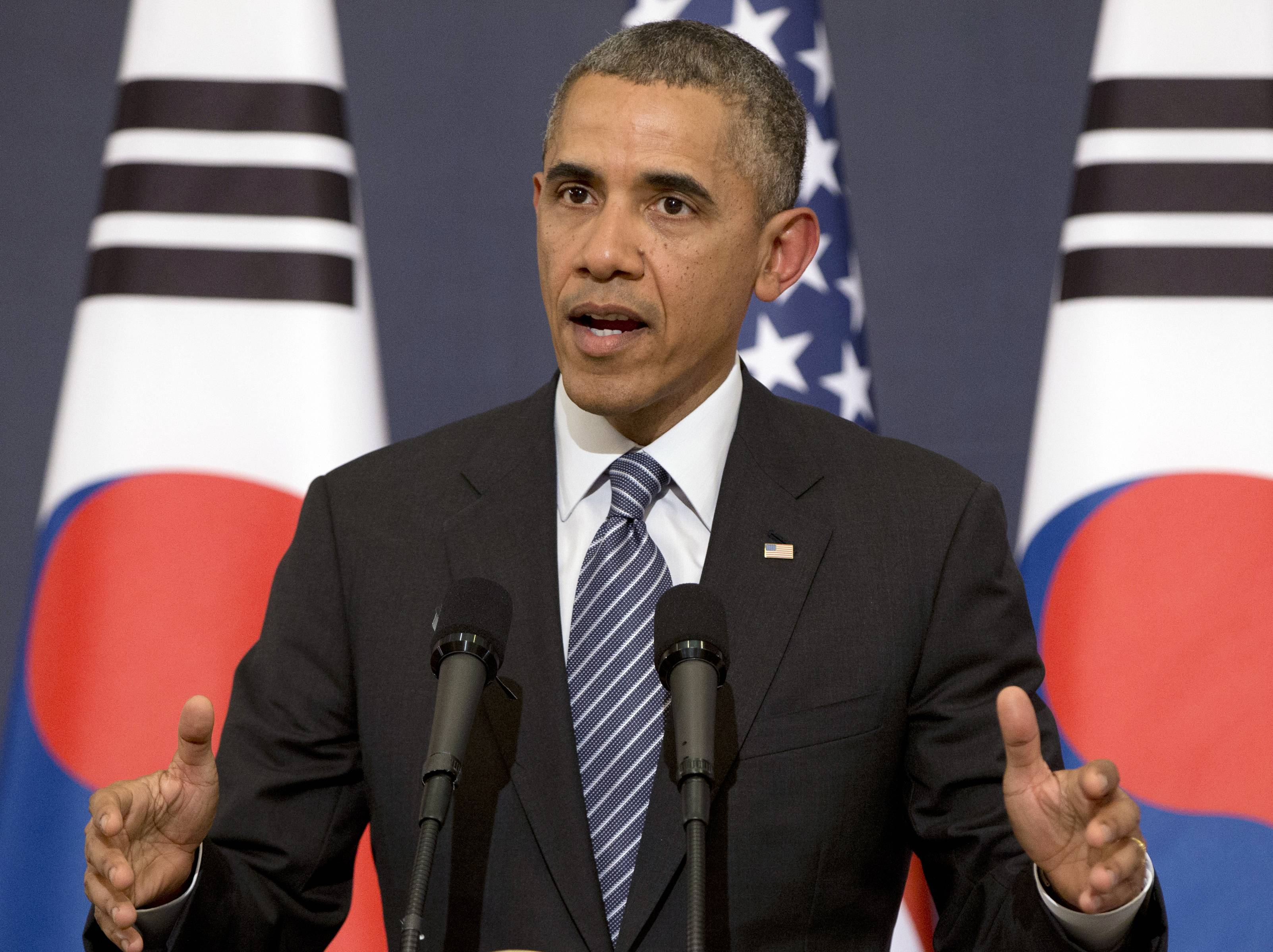 U.S. President Barack Obama gestures as he speaks during a joint news conference with South Korean President Park Geun-hye at the Blue House, Friday, April 25, 2014, in Seoul, South Korea. The U.S. and Europe are laying the groundwork to sanction broad sections of Russia's economy if Moscow invades eastern Ukraine, Obama said Friday, even as he acknowledged those sanctions may fail to deter Vladimir Putin.