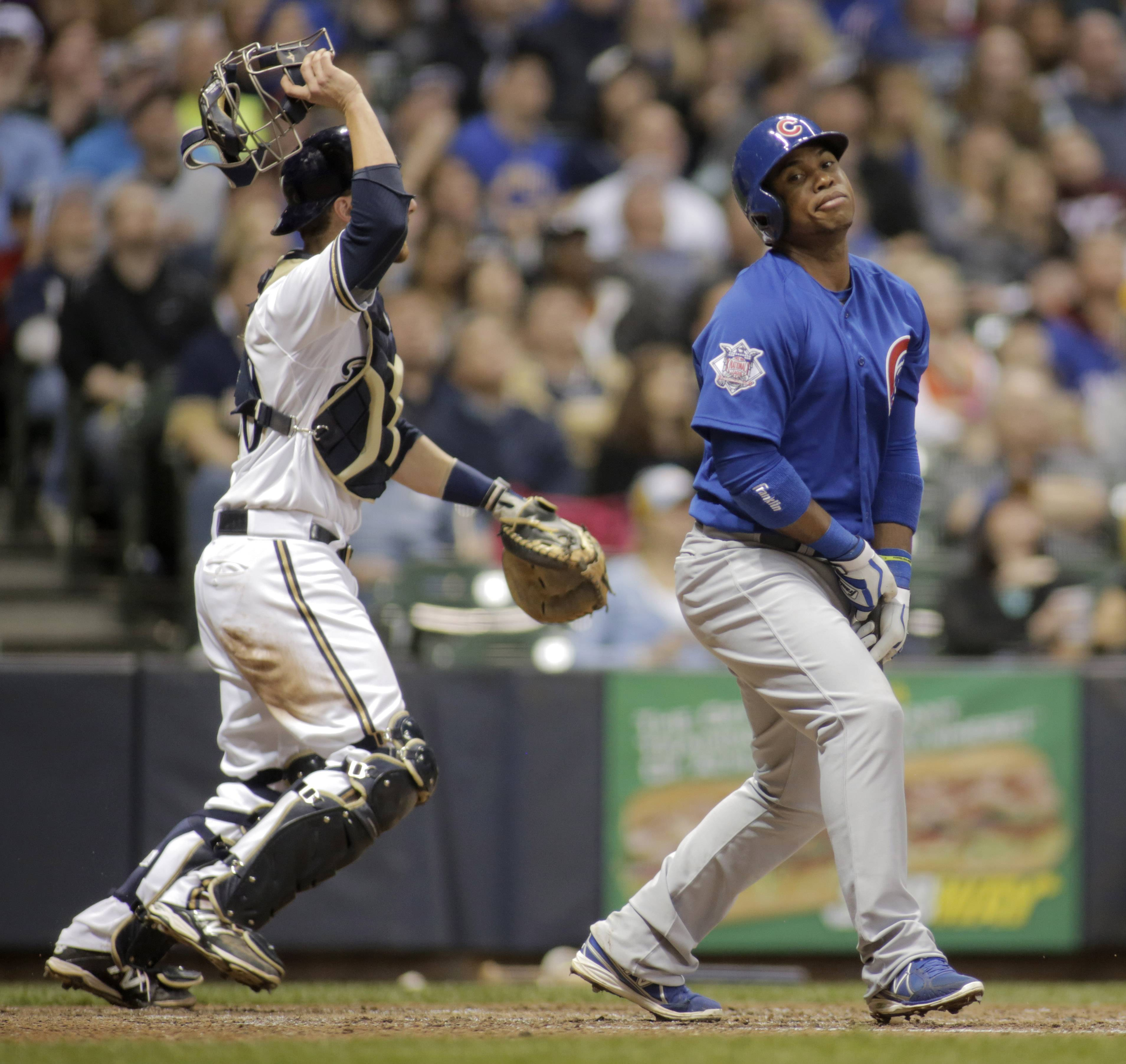 Cubs third baseman Luis Valbuena reacts after popping out against the Milwaukee Brewers during the sixth inning of a baseball game Friday, April 25, 2014, in Milwaukee.