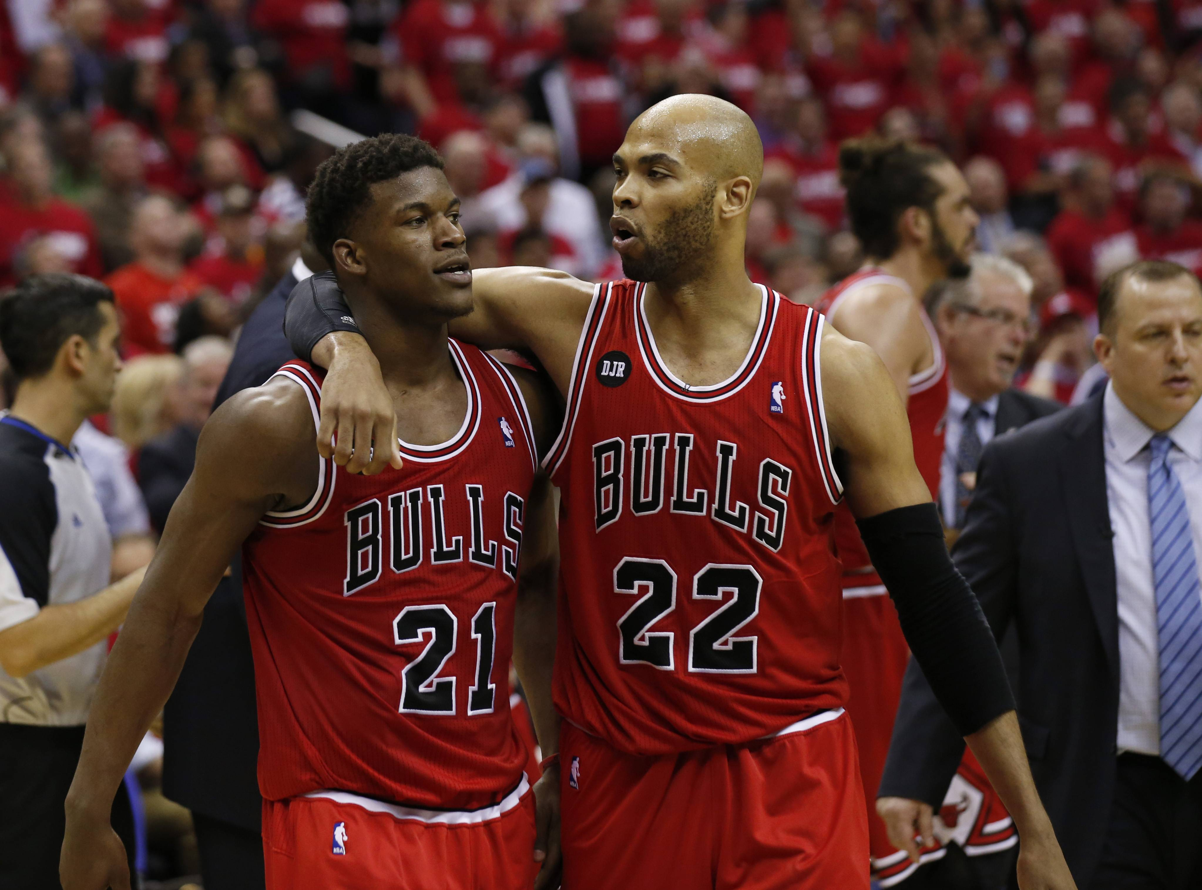 Bulls guard Jimmy Butler (21) is pulled away by forward Taj Gibson (22) after an altercation with Washington Wizards forward Nene in the second half of Game 3 of an opening-round NBA basketball playoff series Friday night. Nene received a double technical and was ejected. The Bulls won 100-97.