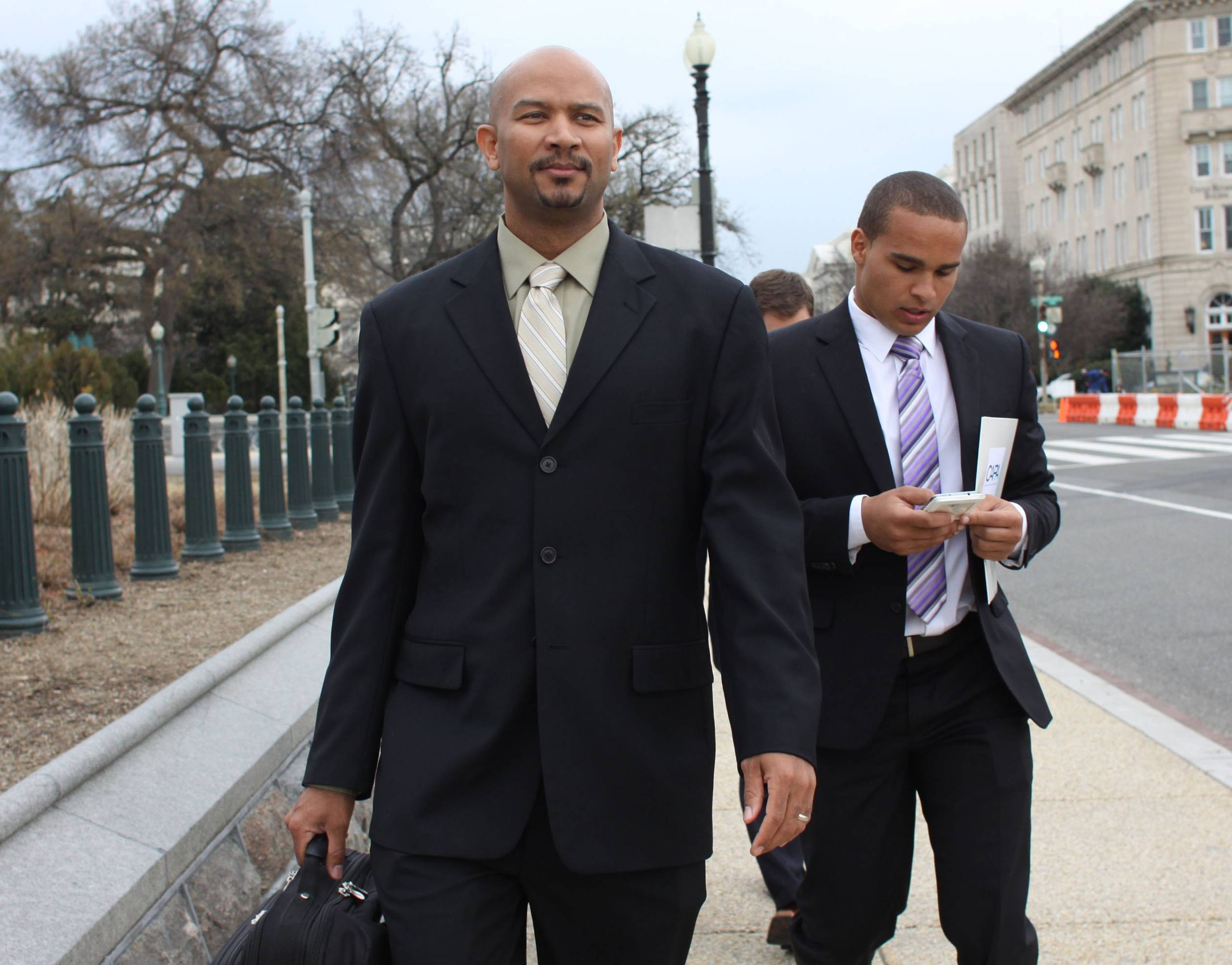 Former Northwestern quarterback Kain Colter, right, and Ramogi Huma, founder and president of the National College Players Association, in Washington.