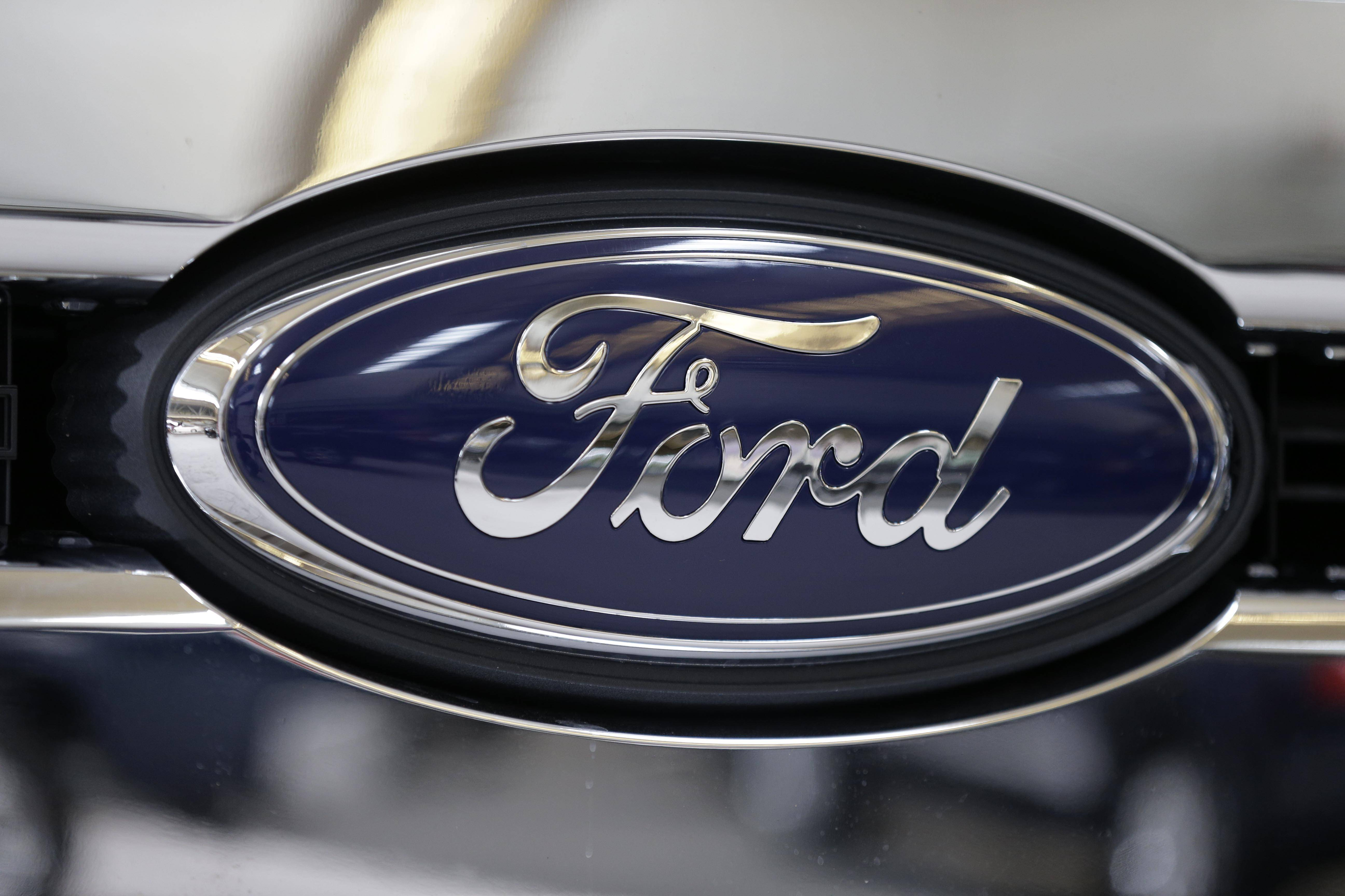 Ford Motor Co.'s worldwide sales rose in the first quarter, propelled by growing strength in Asia and Europe. But weakness in North America dragged down the company's profit.