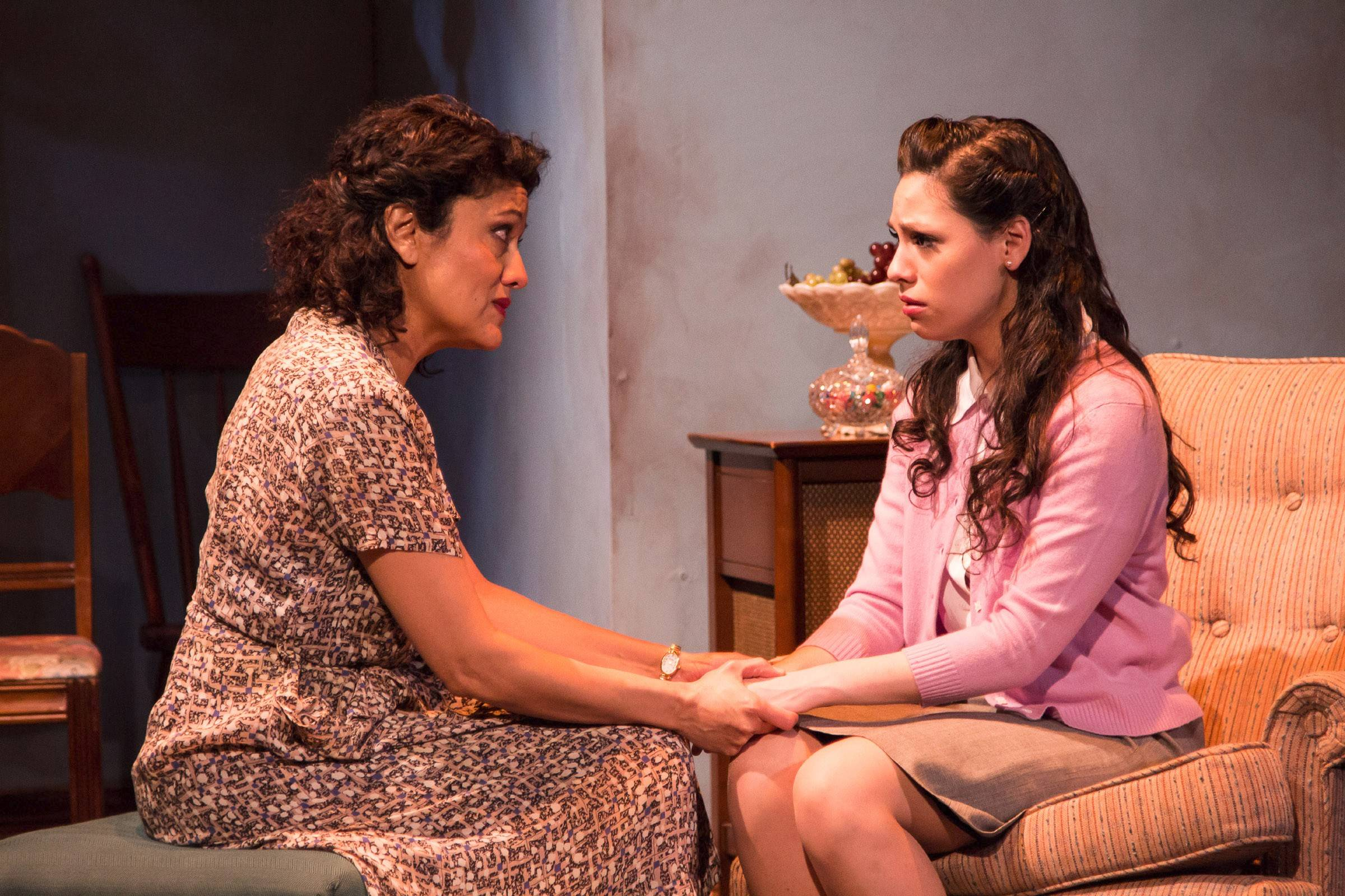 "Beatrice (Sandra Marquez) confronts Catherine (Ayssette Munoz) about modifying her behavior now that she's becoming a woman in Teatro Vista's revival of Arthur Miller's ""A View from the Bridge,"" directed by artistic director Ricardo Gutierrez."