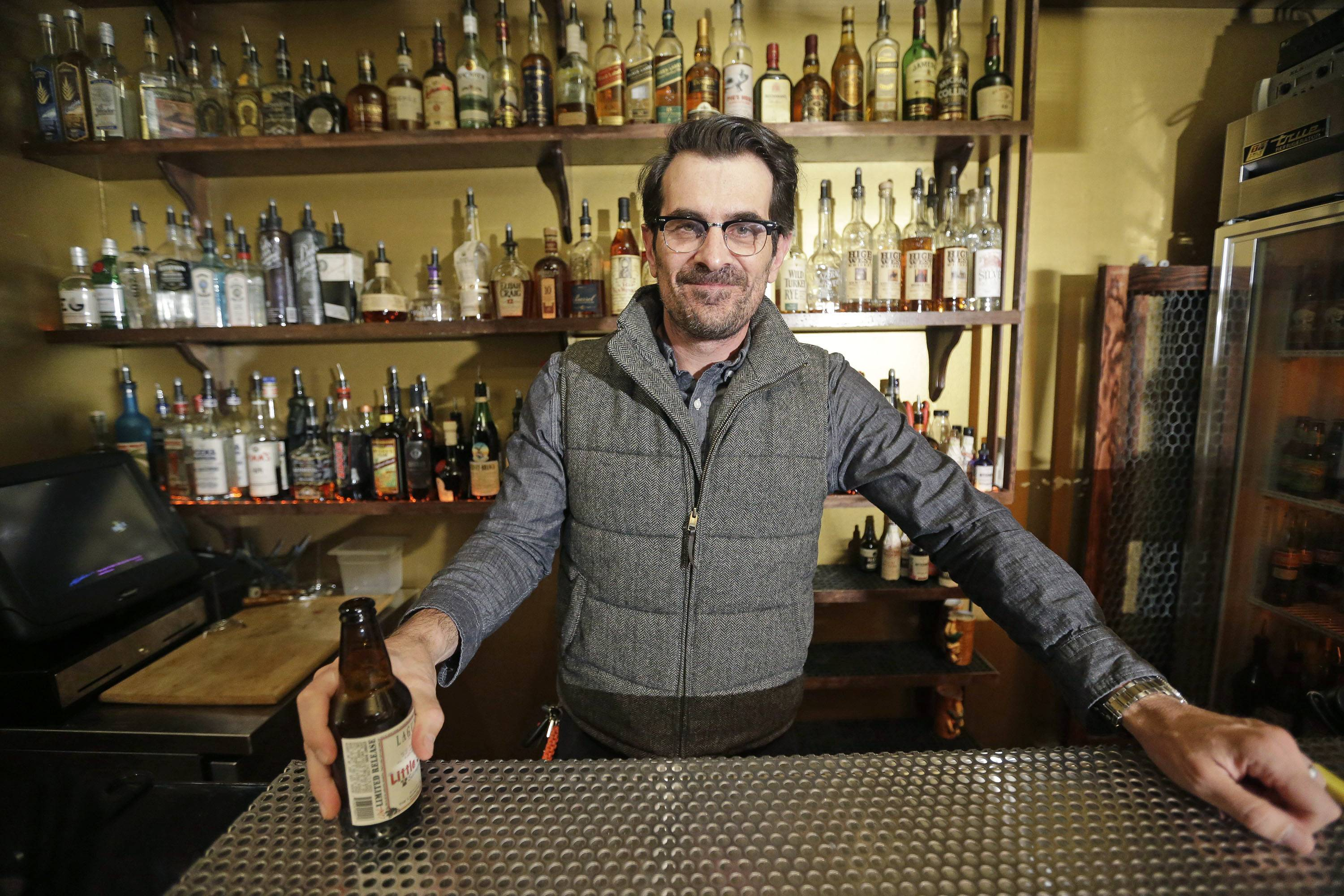 "Actor Ty Burrell, who plays bumbling dad Phil Dunphy on ABC's ""Modern Family,"" has a beer at Bar X, the cocktail bar he co-owns in Salt Lake City. Burrell just opened Beer Bar, a beer garden-like eatery next door to Bar X that serves 150 beers paired up with an array of house-made bratwursts, local breads and Belgian fries."