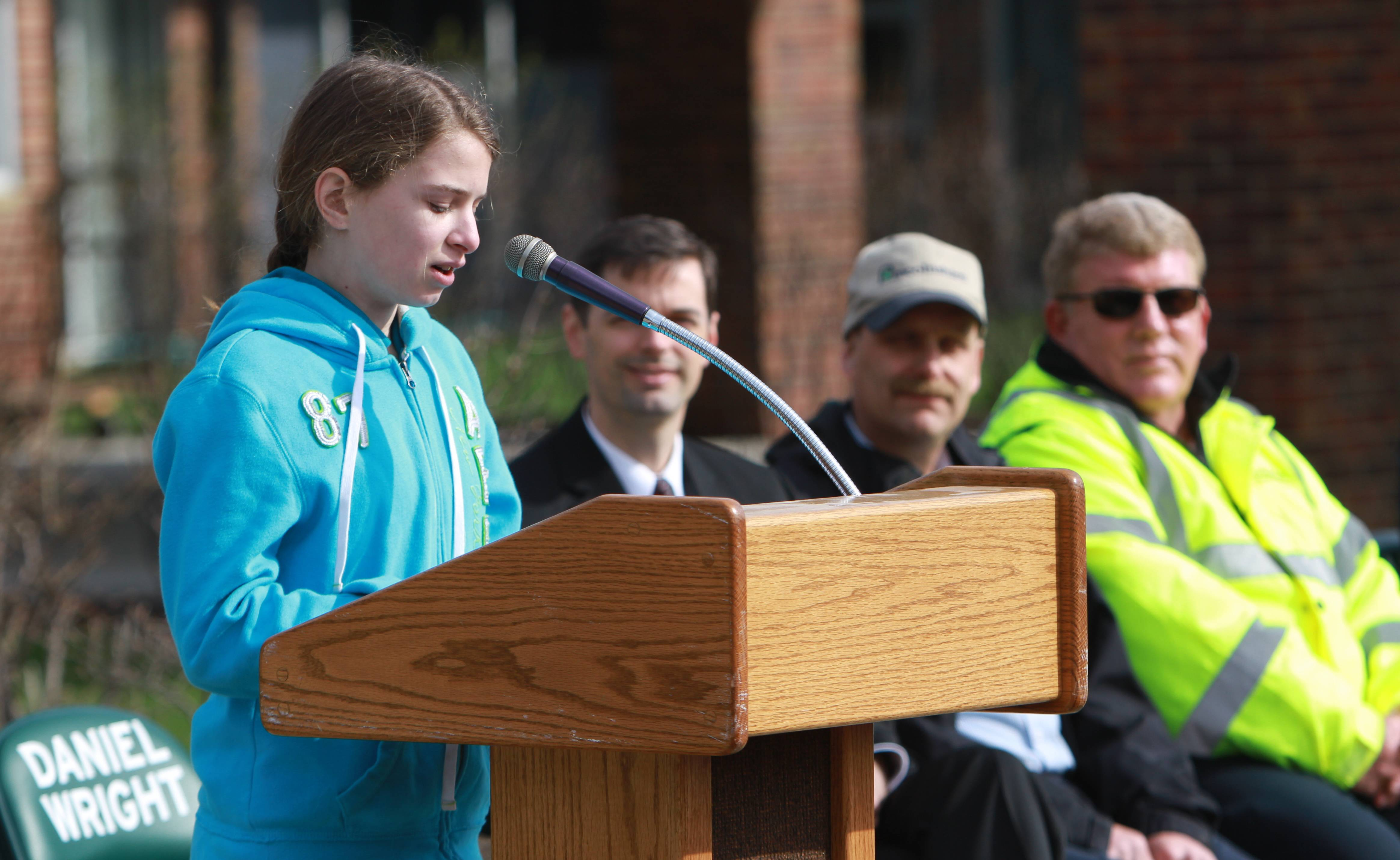 Ellie Warren, a fifth grade student at Daniel Wright Elementary School, speaks about the history of Arbor Day during a tree-planting ceremony Friday at the Lincolnshire school.