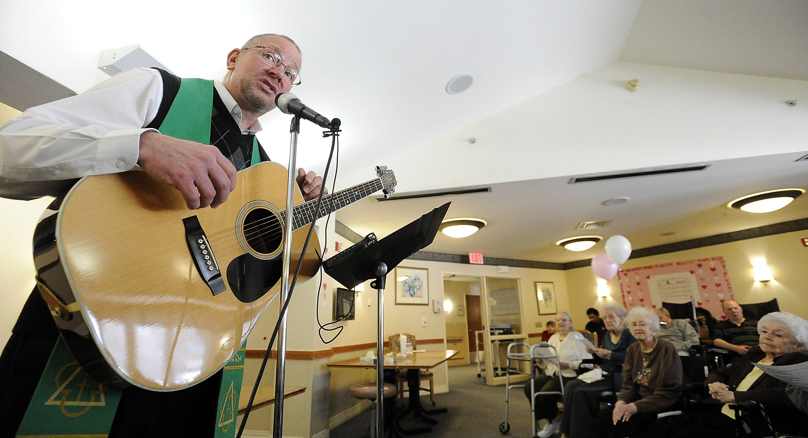 "The Rev. Shawn Kafader leads worship services for residents at Friendship Village in Schaumburg with his guitar, singing songs of faith. He further lightens the mood for residents by mixing in such golden oldies as ""Take Me Out to the Ballgame"" and ""In the Good' Ol Summertime."""