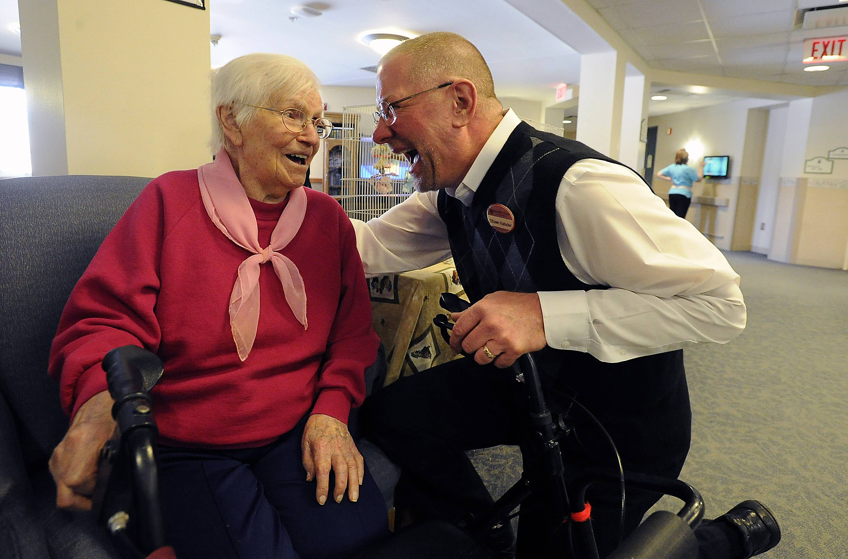 Kafader visits with Julia Petras, 104, after she attended his afternoon worship service. Kafader is chaplain at Friendship Village in Schaumburg.
