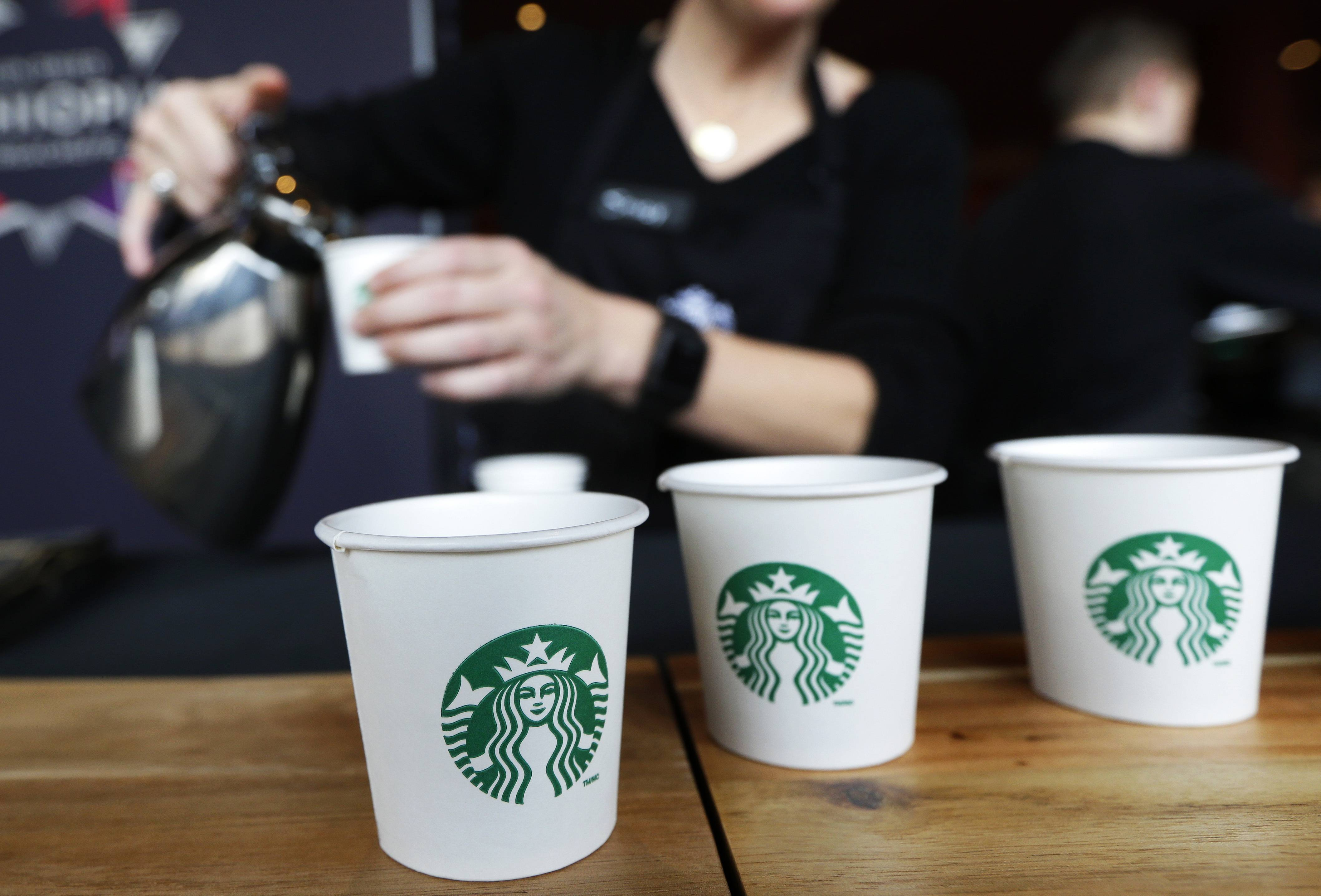 Starbucks reported a stronger quarterly profit on Thursday as customers in the U.S. continued shelling out more money at its cafes.
