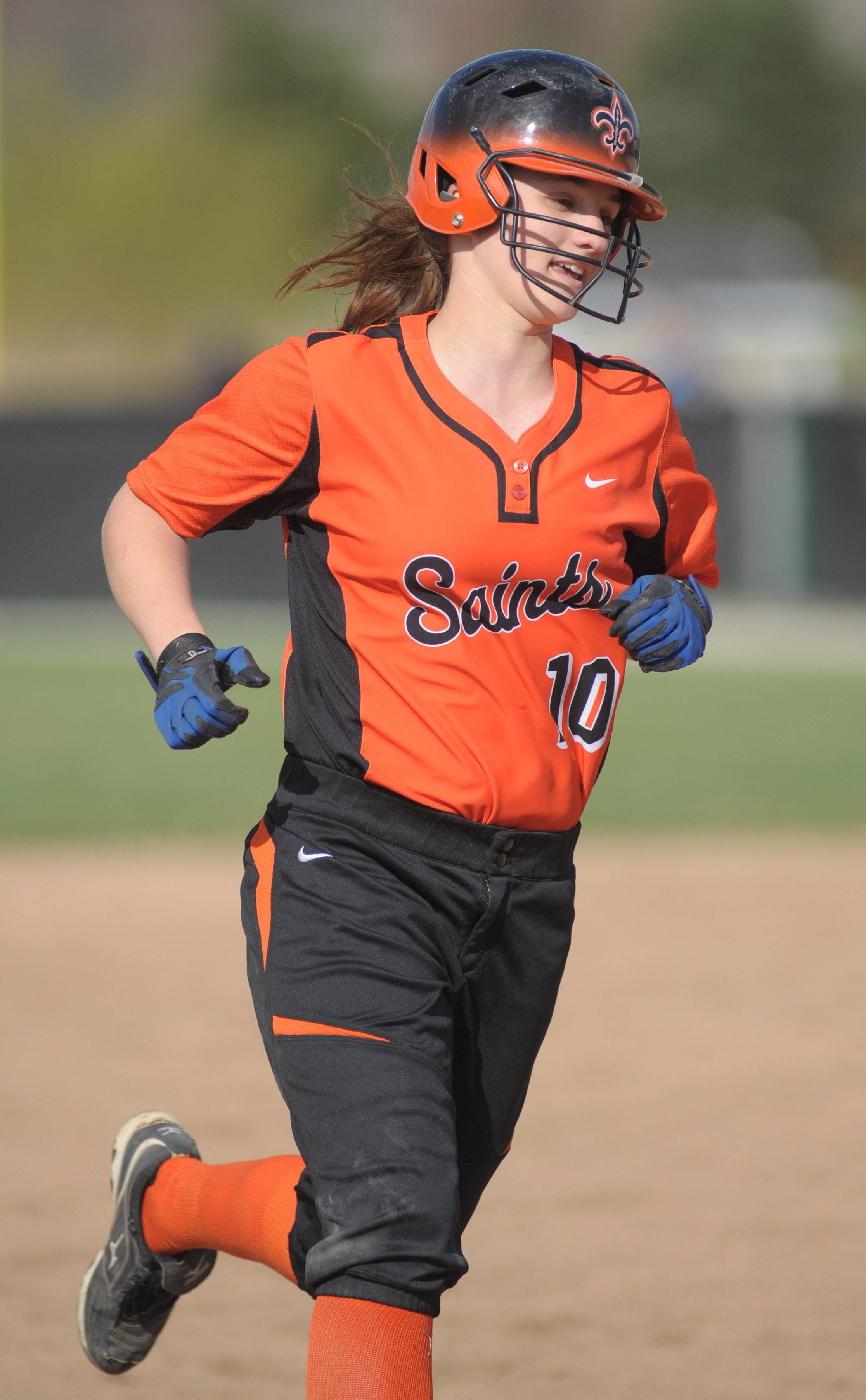 St. Charles East's Kate Peterburs rounds third base after her home run hit in the first inning vs. Lyons on Friday, April 25.