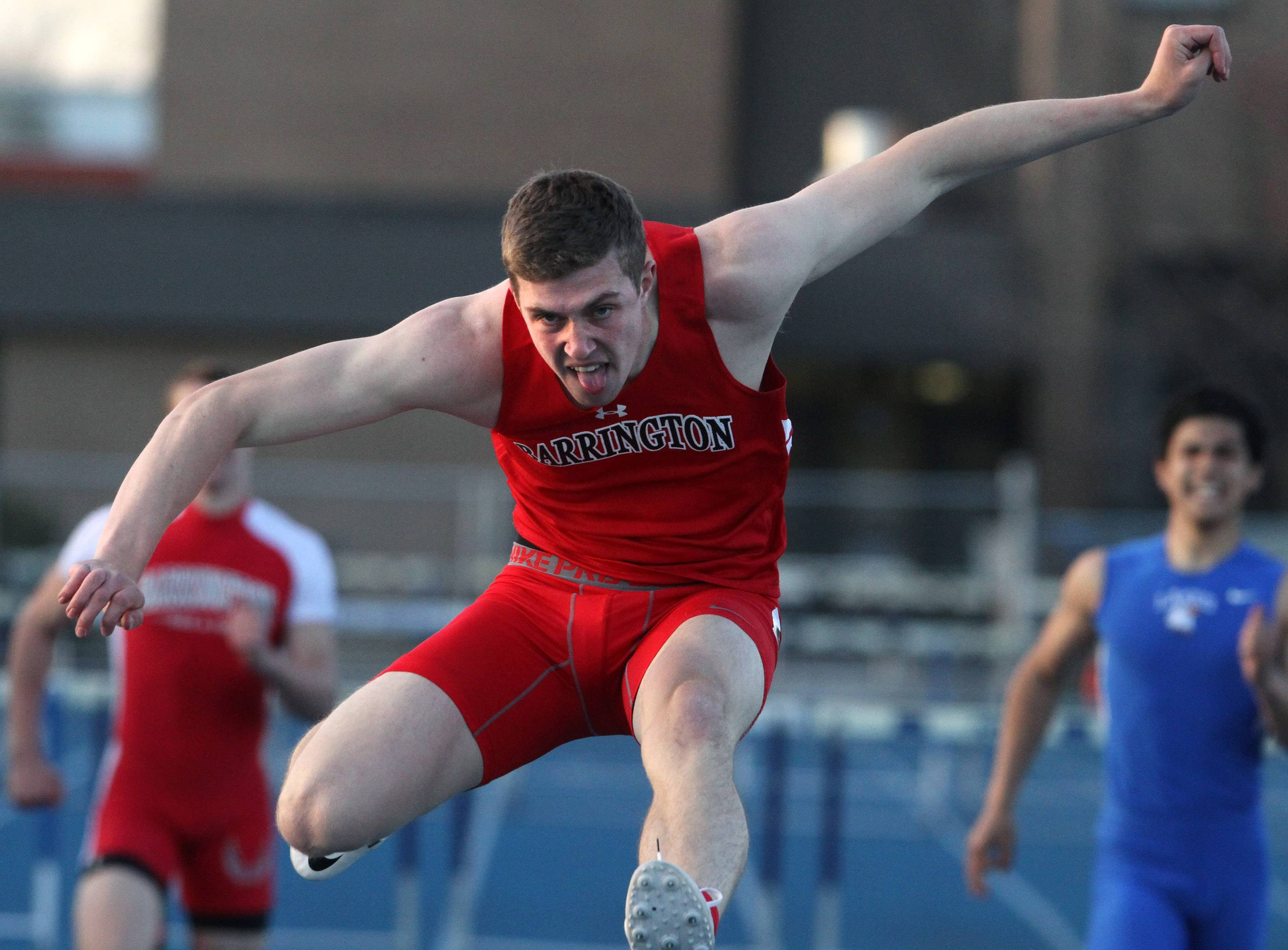 Barrington's Parker Deloye finishing first in the 300-meter hurdles at the Lake Zurich boys track invite on Friday.