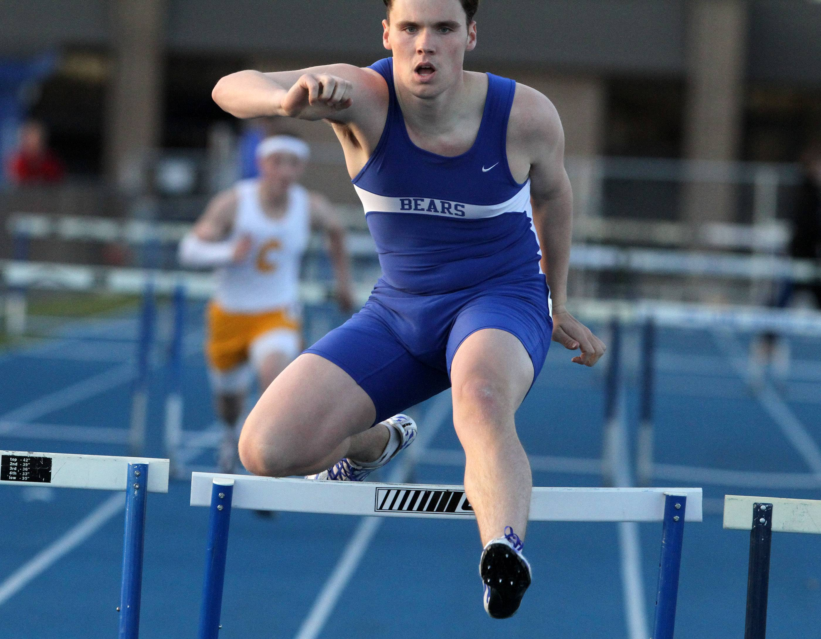 Lake Zurich's Ryan Fitzgerald competes in the first heat of the 300-meter hurdles at the Lake Zurich boys track invite on Friday.