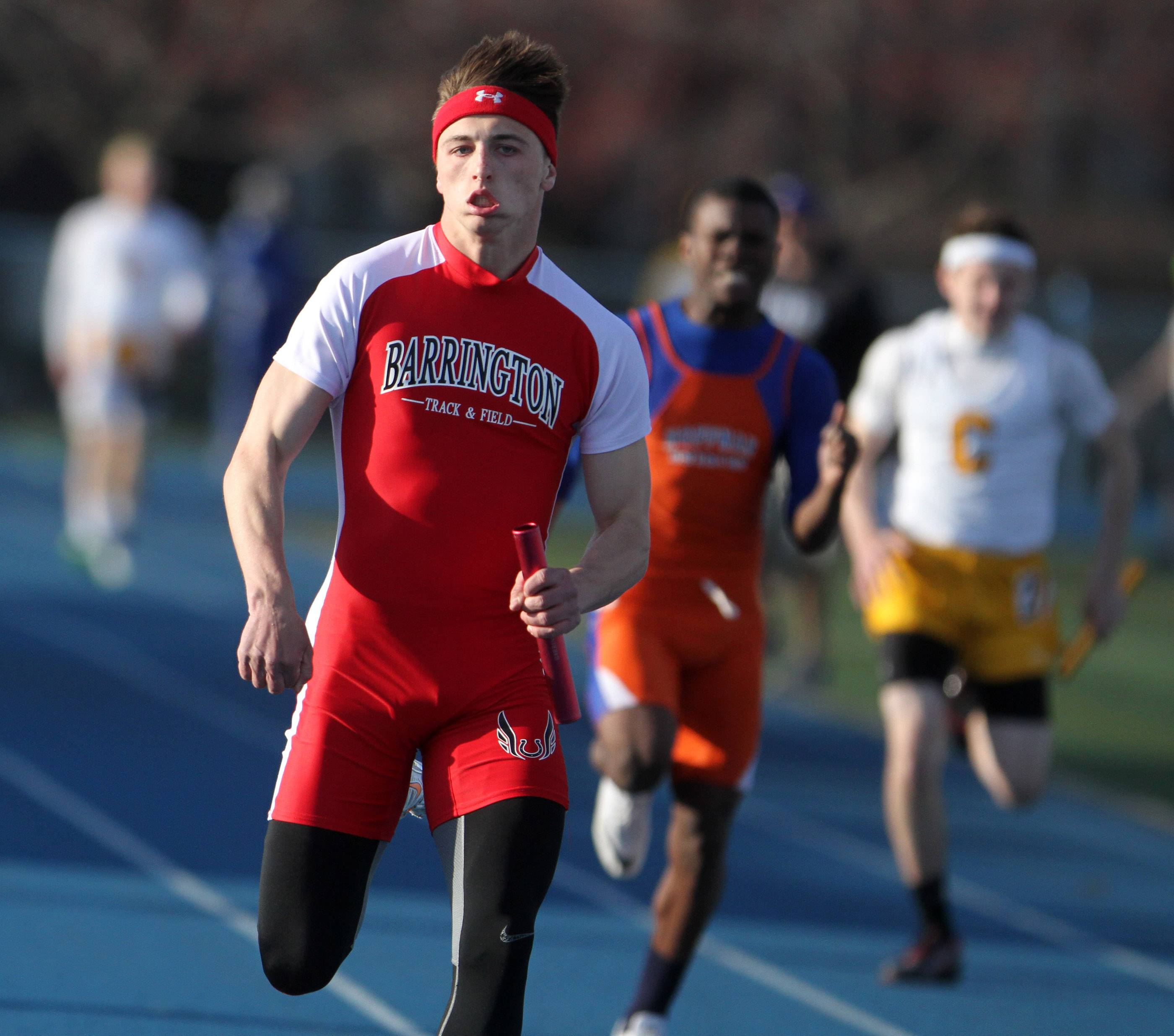 Barrington placed first in the 400-meter relay as J.P. Brooks crosses the finish line at the Lake Zurich boys track invite on Friday.