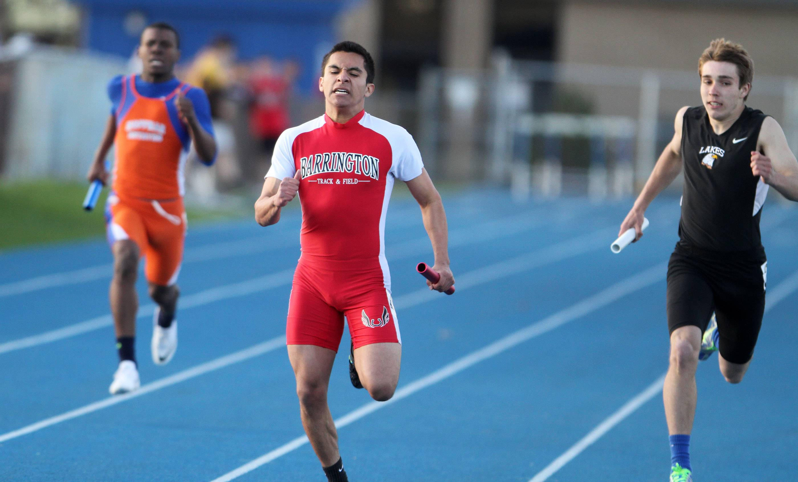 Barrington places first in the 4 x 200 meter relay as Cristian Ocampo crosses the finish line at the Lake Zurich boys track invite on Friday.