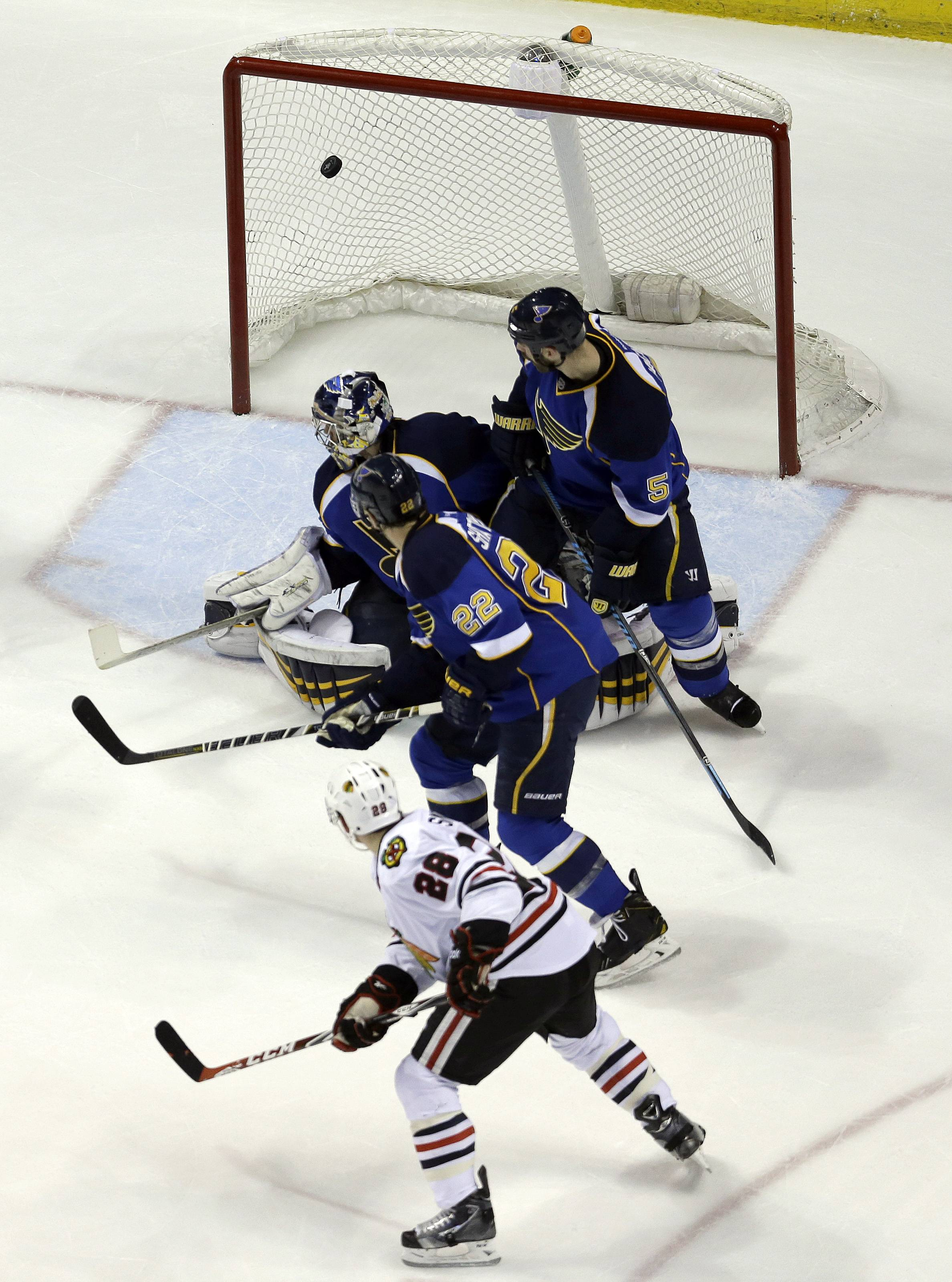 Chicago Blackhawks' Ben Smith (28) scores past St. Louis Blues goalie Ryan Miller, Kevin Shattenkirk (22) and Barret Jackman (5) during the second period.