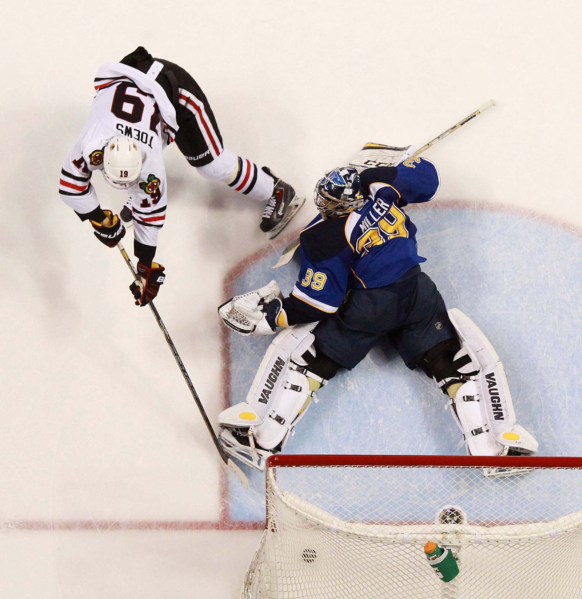 Chicago Blackhawks center Jonathan Toews scores the game-winning goal in overtime past St. Louis Blues goaltender Ryan Miller during Game 5.