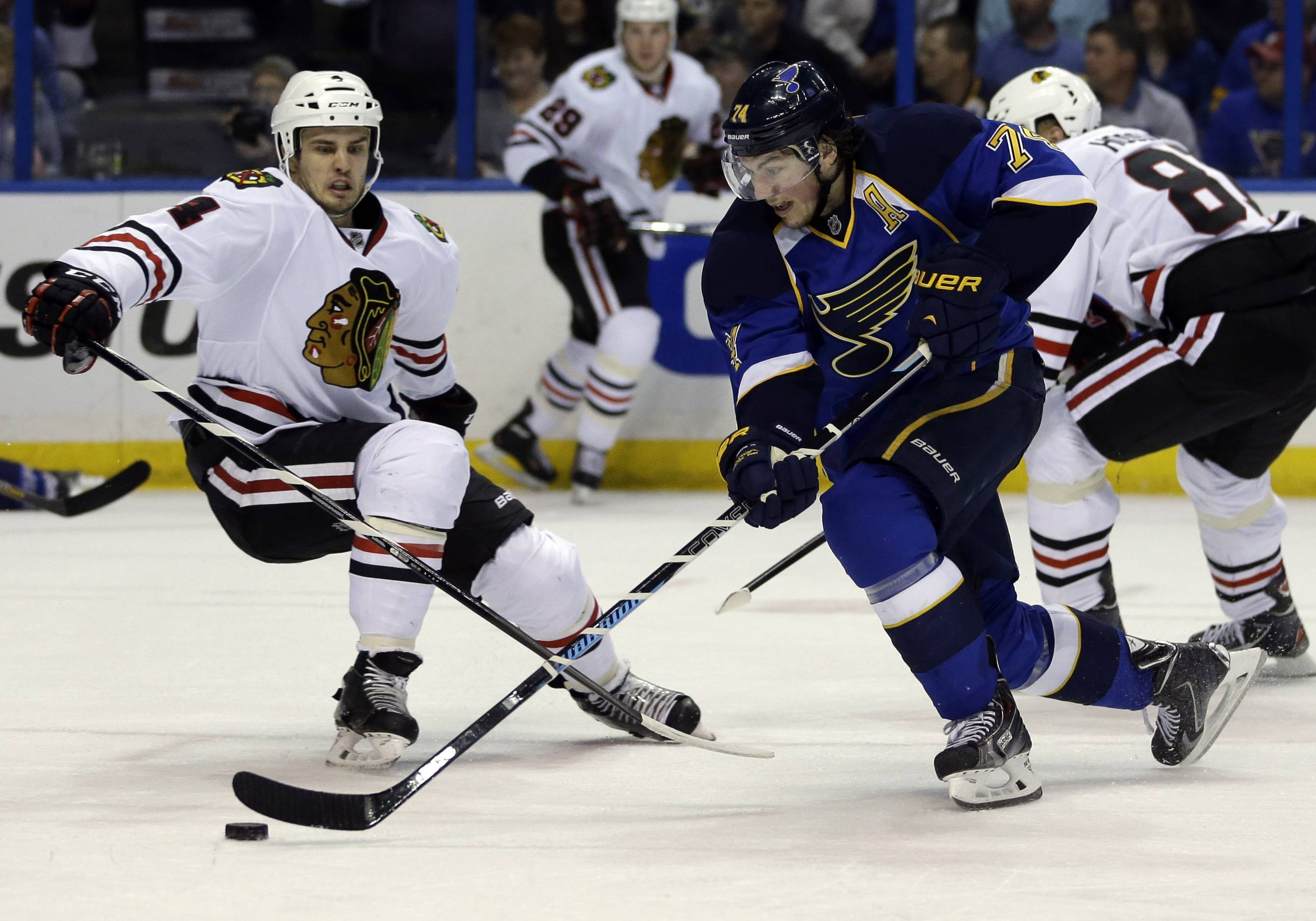 St. Louis Blues' T.J. Oshie, right, slips past Chicago Blackhawks' Niklas Hjalmarsson, of Sweden, on his way to score during the second period.