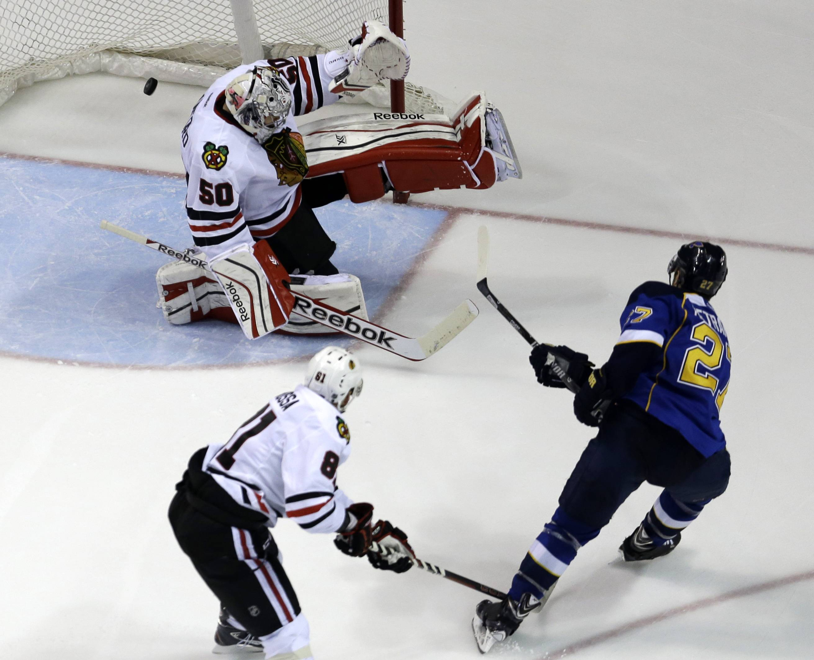 St. Louis Blues' Alex Pietrangelo, right, scores past Chicago Blackhawks goalie Corey Crawford (50) as Blackhawks' Marian Hossa, of Slovakia, watches during the third period.
