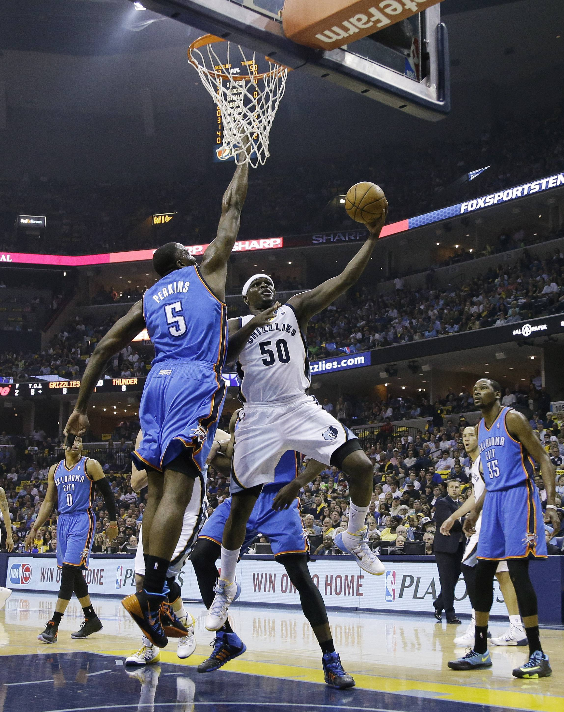 Memphis Grizzlies forward Zach Randolph (50) scores against Oklahoma City Thunder center Kendrick Perkins (5) in the first half of Game 3 of an opening-round NBA basketball playoff series Thursday, April 24, 2014, in Memphis, Tenn.