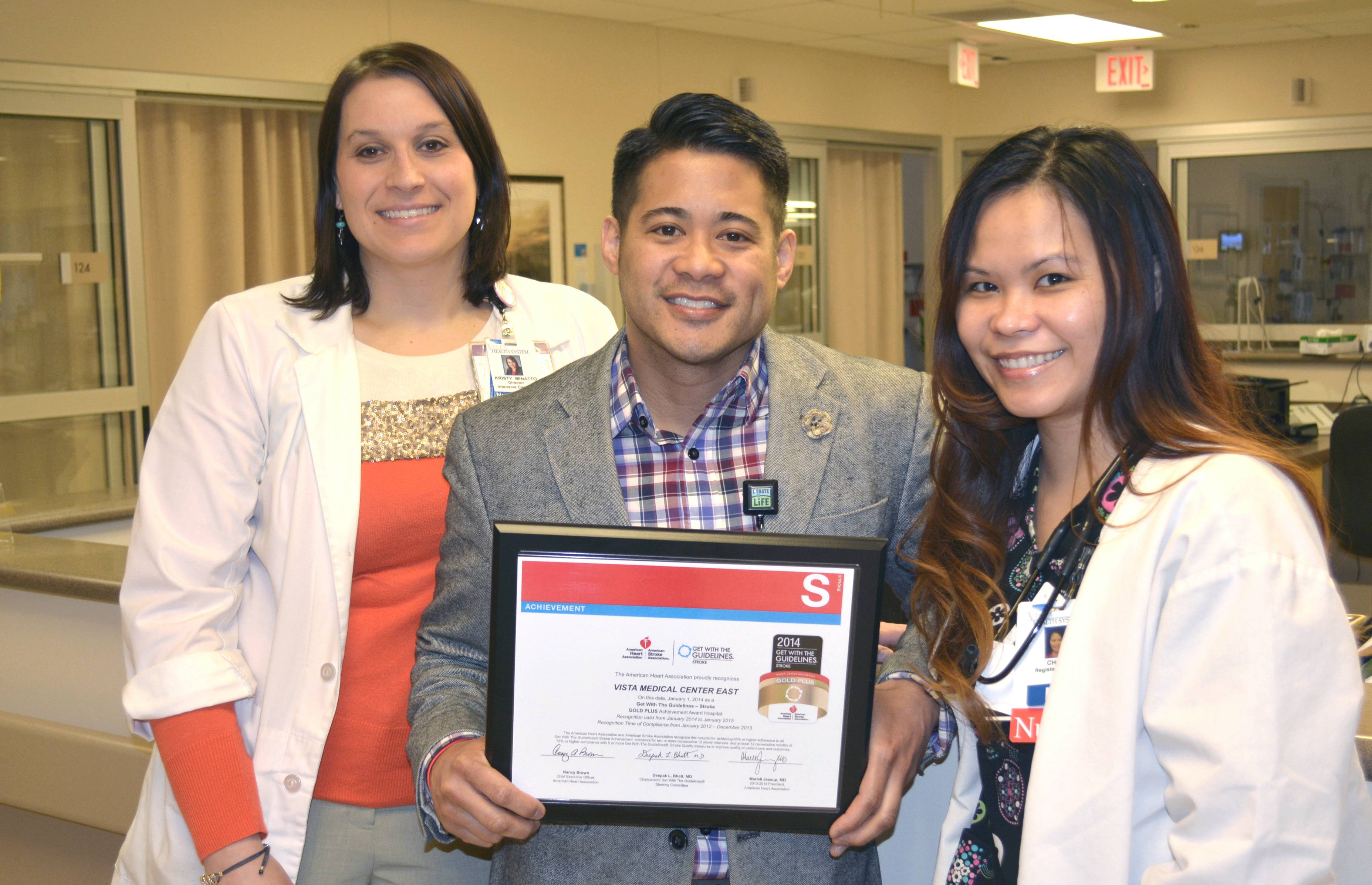 Kristy Minatto, RN and ICU Manager, Cliff Hidalgo, RN and Stroke Coordinator, and Che Estrella, RN and ICU nurse, hold the award in the Vista East ICU.John Griffin
