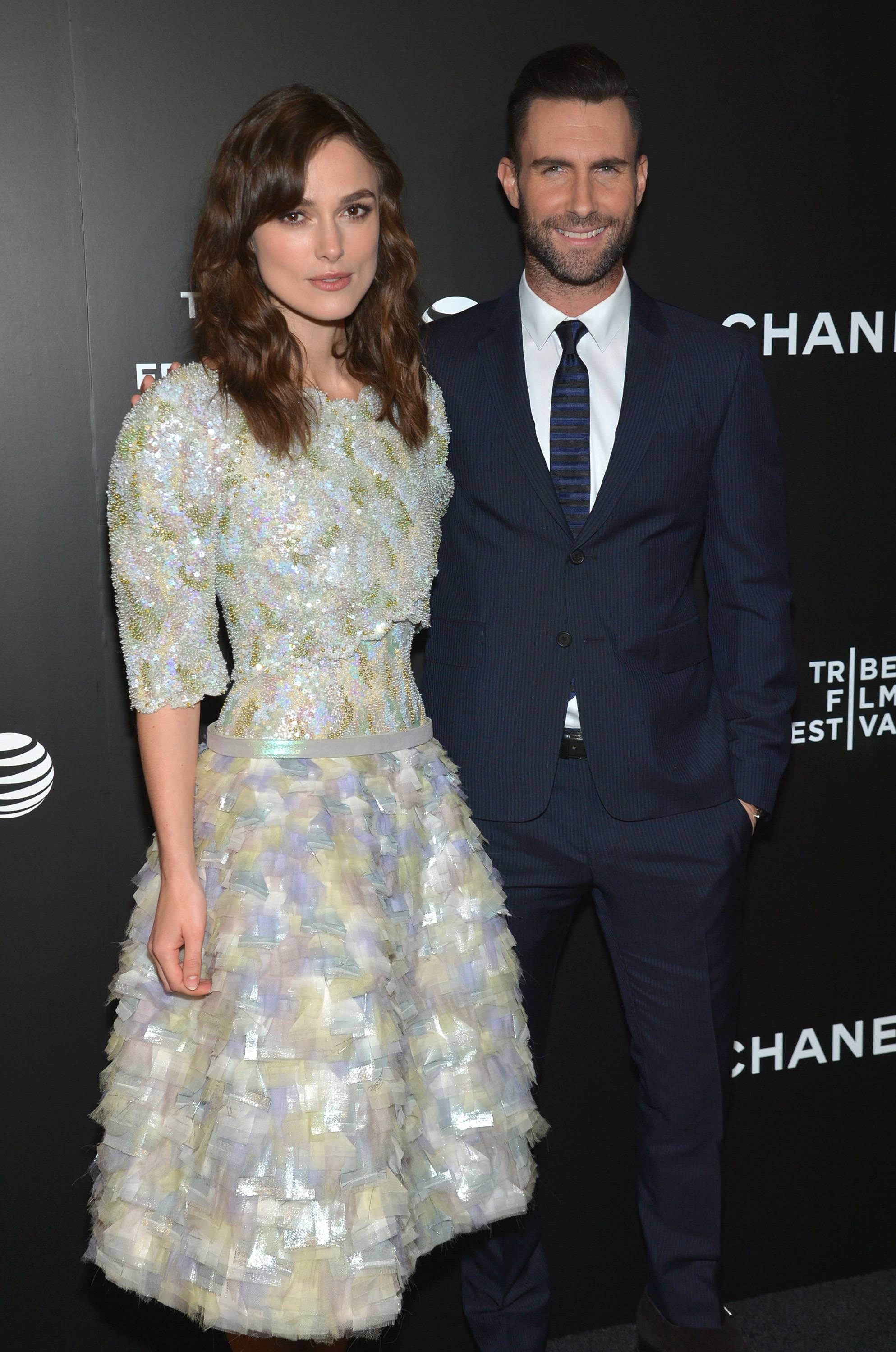 "Keira Knightley, left, and Adam Levine arrive at the premiere of ""Begin Again"" at the Tribeca Film Festival on Saturday in New York."