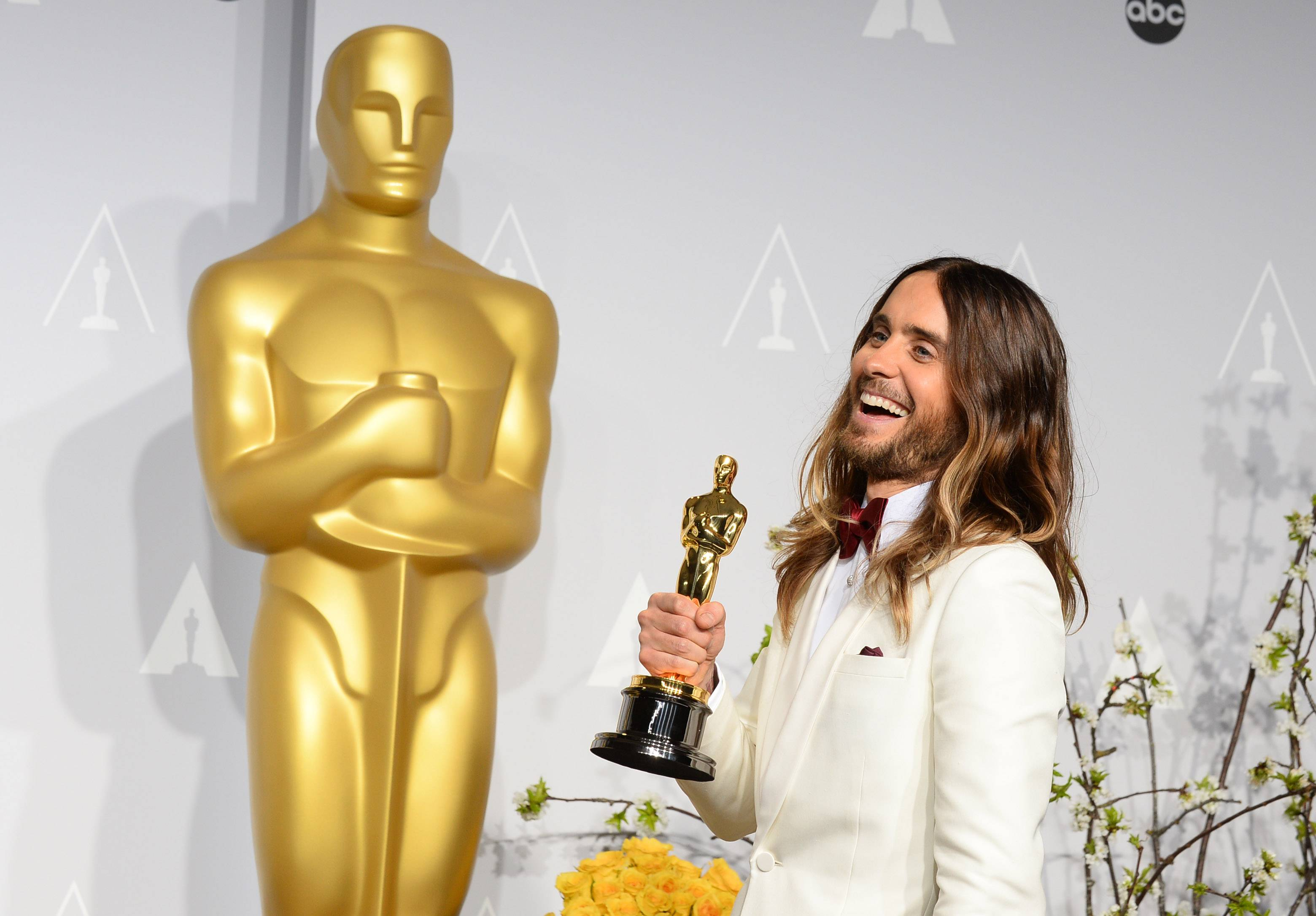 "Jared Leto poses in the press room with the award for best actor in a supporting role for ""Dallas Buyers Club"" during the Oscars."