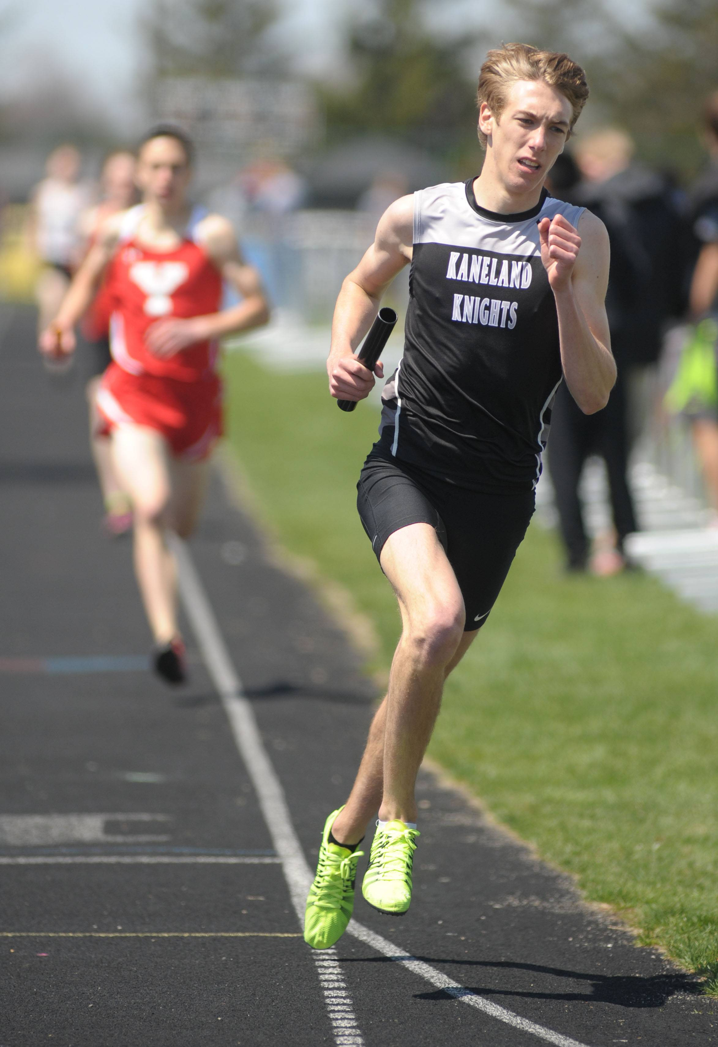 Kaneland's Kyle Carter leads the Knights in the 4 x 800 meter relay at Kaneland's Peterson Prep Invitational on Saturday, April 26. The team would go on to break the Illinois state record for the event.