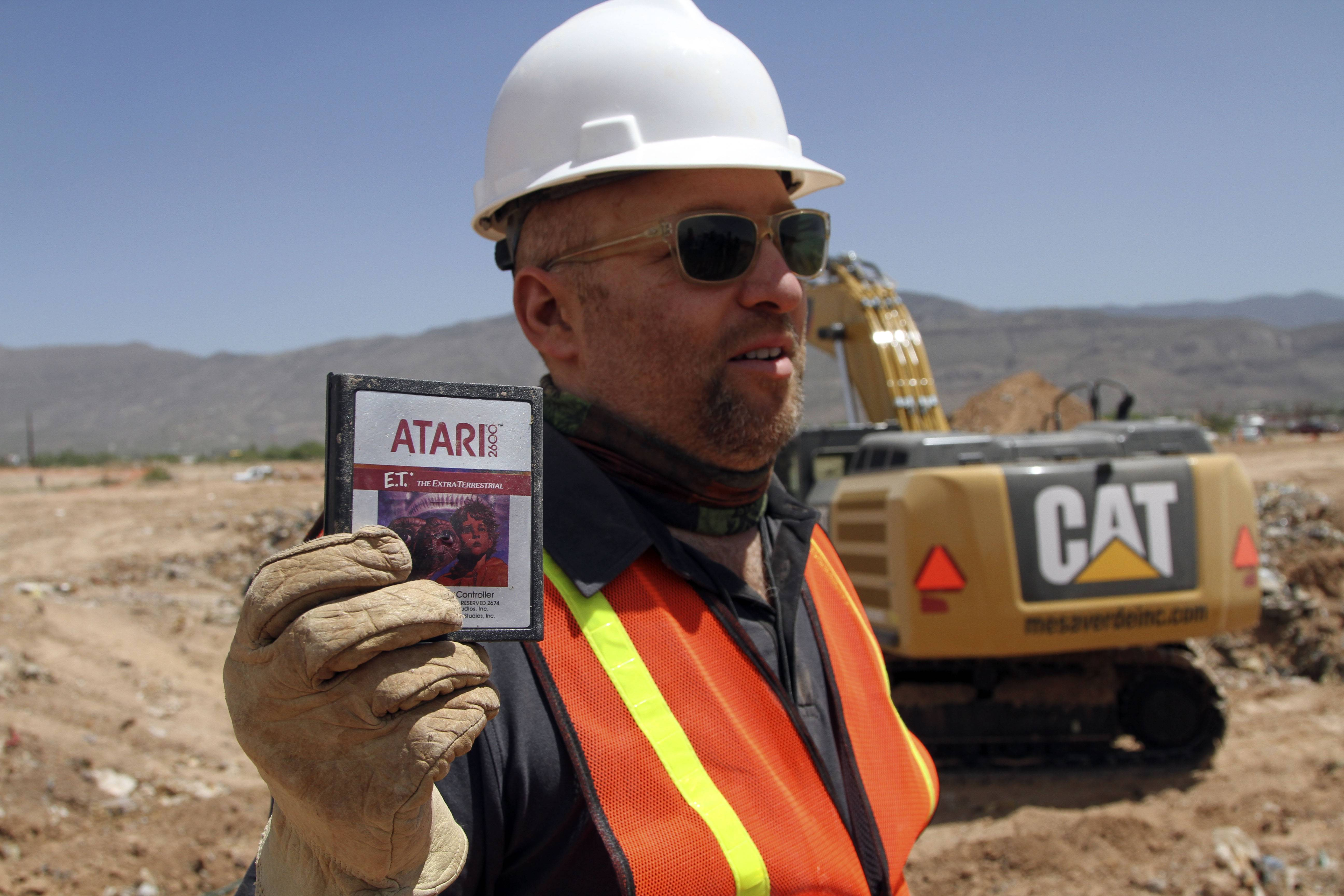 Film Director Zak Penn shows a box of a decades-old Atari 'E.T. the Extra-Terrestrial' game found in a dumpsite in Alamogordo, N.M., Saturday. Producers of a documentary dug in a southeastern New Mexico landfill in search of millions of cartridges of the game that has been called the worst game in the history of video gaming and were buried there in 1983.