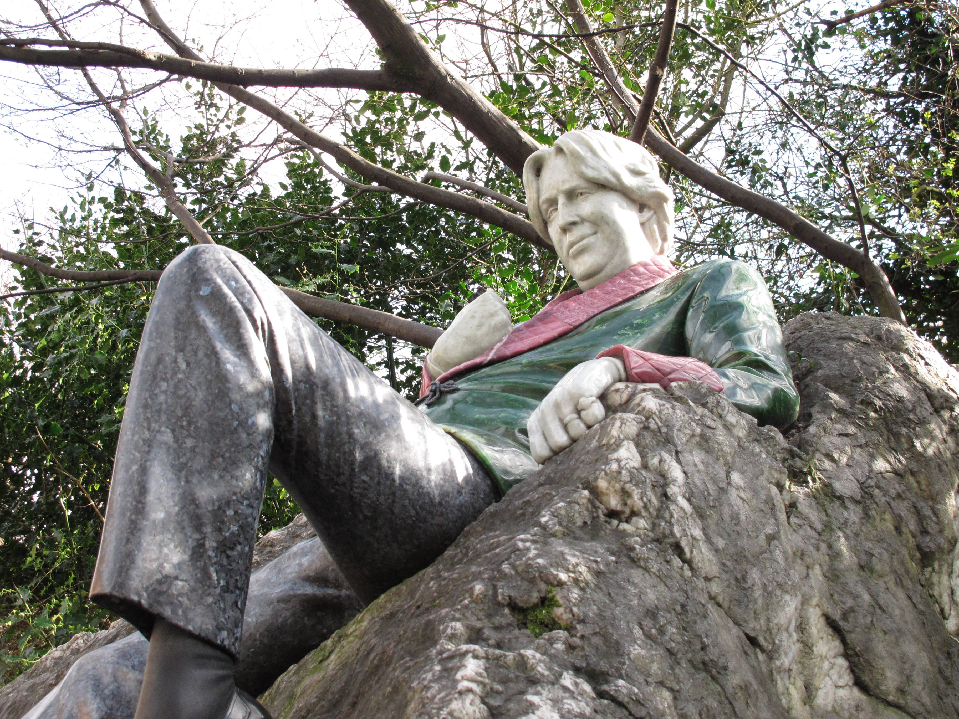 "A stone version of Oscar Wilde lounges on a rock in Merrion Square in Dublin, Ireland. The 19th-century writer and wit (who famously said ""I have nothing to declare but my genius"") is depicted gazing at the house across the street where he once lived."