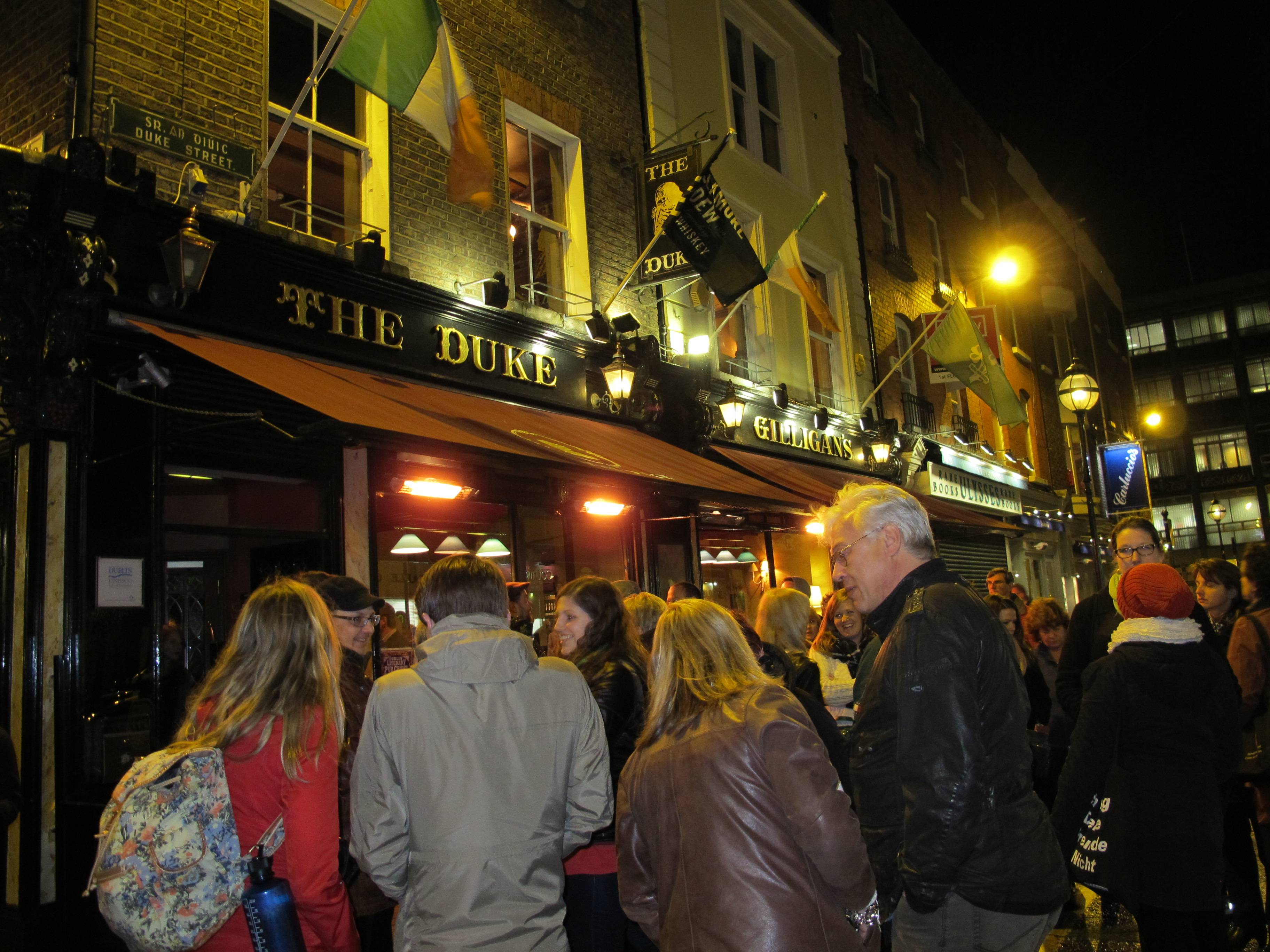 People gather outside the Duke pub in Dublin, Ireland, at the start of a literary pub-crawl. The literary tour takes visitors to several pubs as actors re-enact scenes from the works of James Joyce, Brendan Behan, Oscar Wilde and others.
