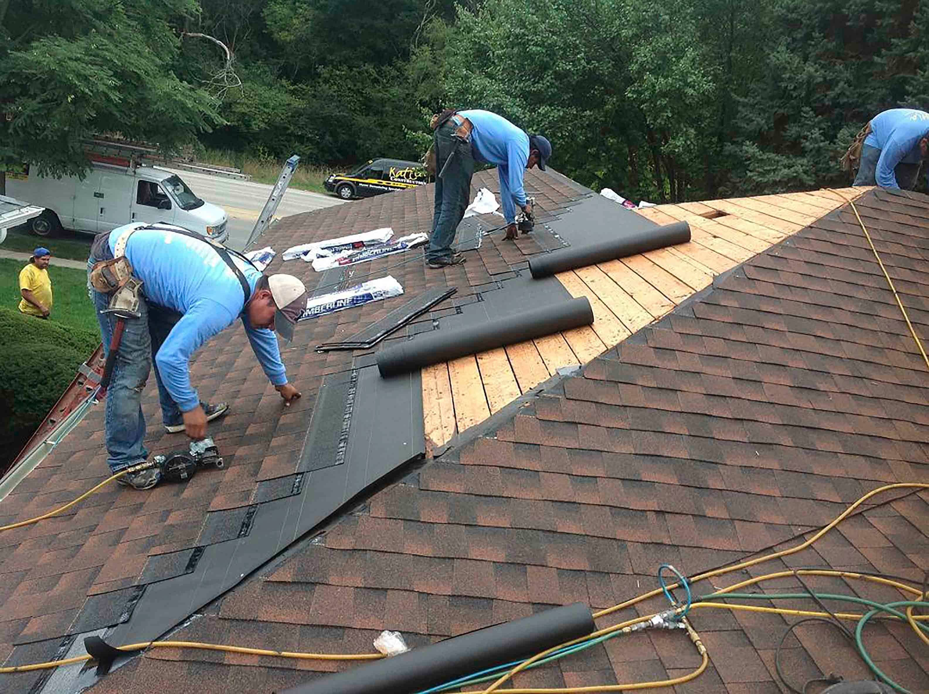 After the roof has been inspected and prepared, new tar paper and new shingles are installed.