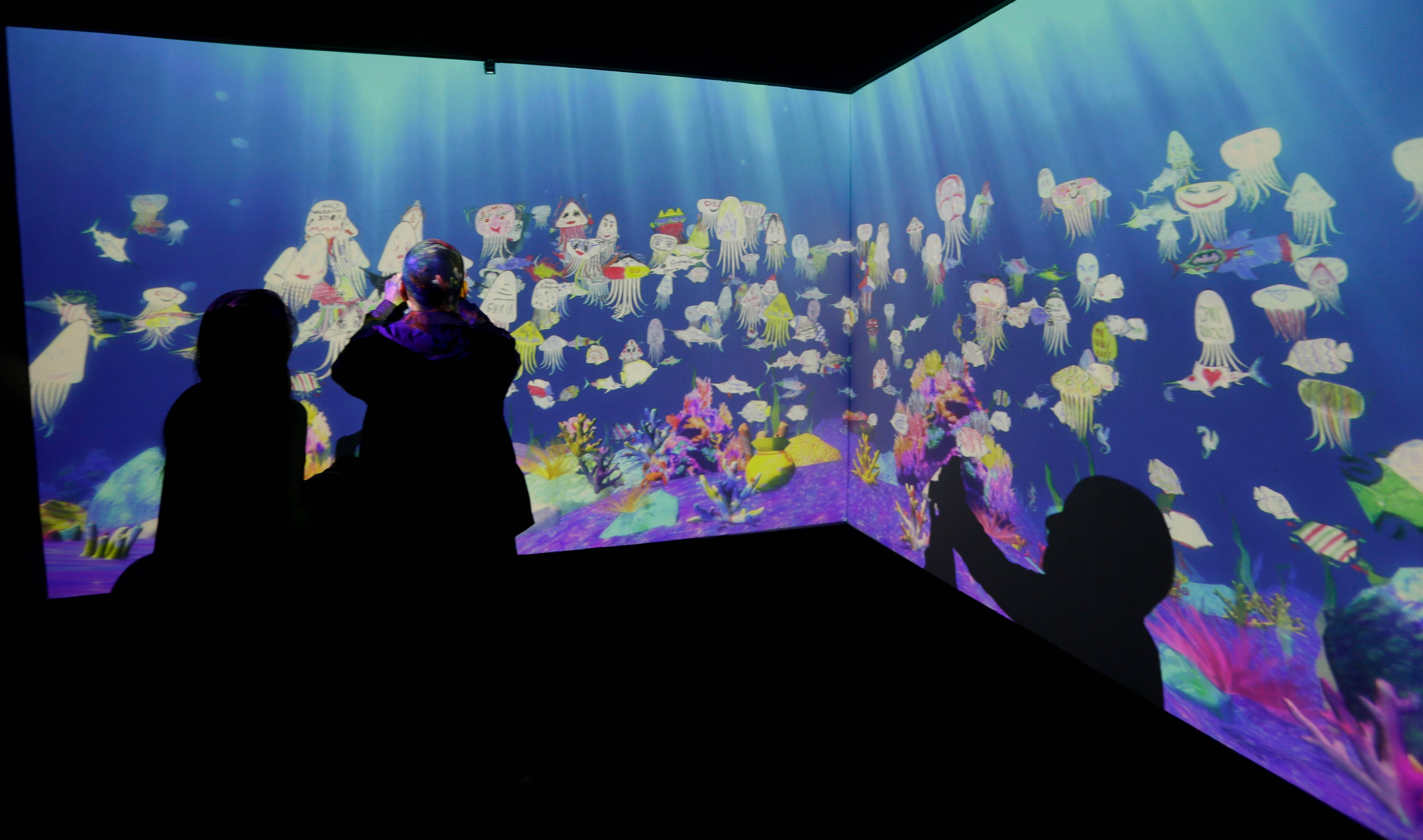A projected interactive aquarium for kids created by Japanese designers teamwork Time Lab is displayed at the Milan Design Fair.