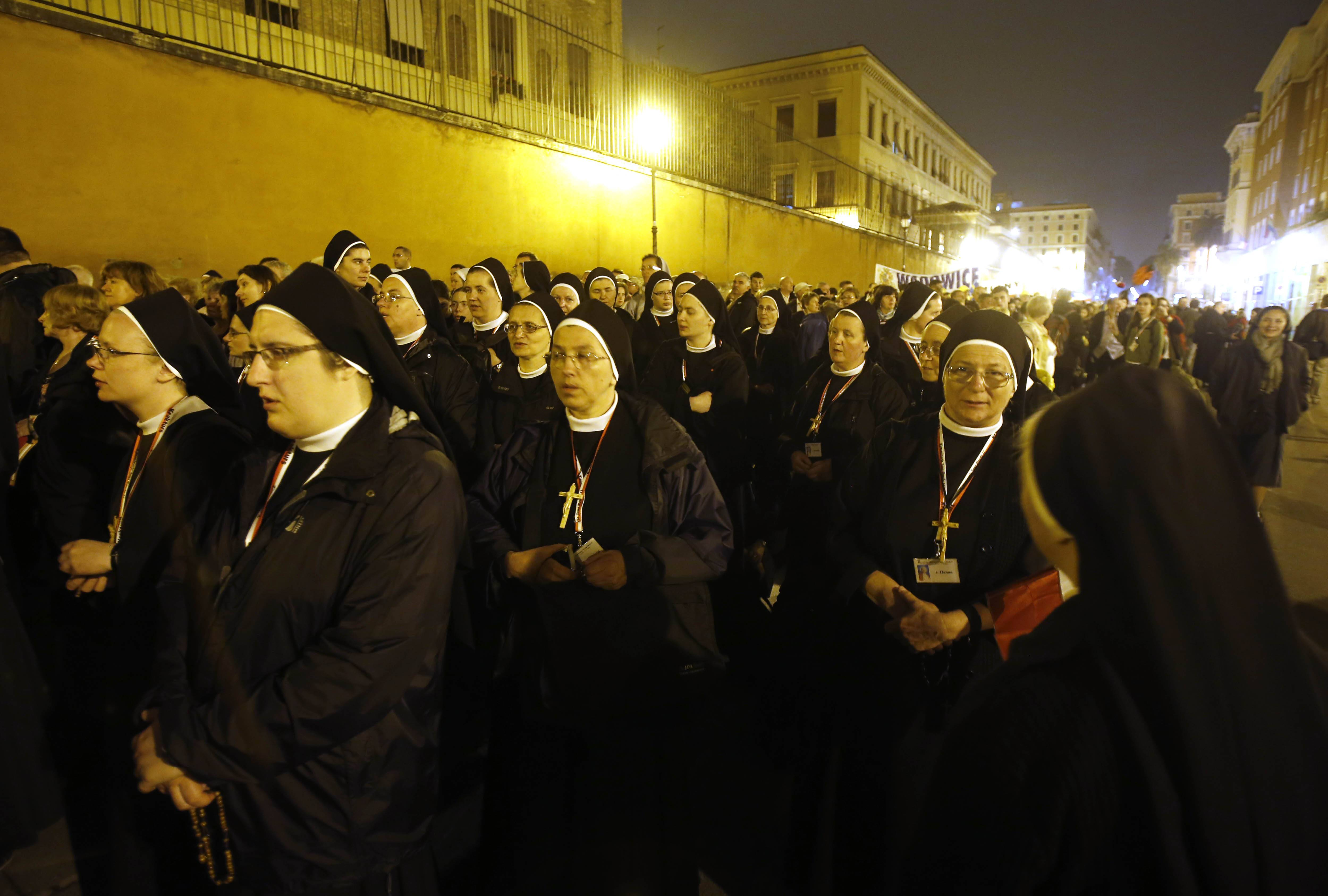 A group of Polish nuns wait to reach St. Peter's Square hours before the ceremony for the canonizations of Pope John XXIII and Pope John Paul II, at the Vatican, Sunday.