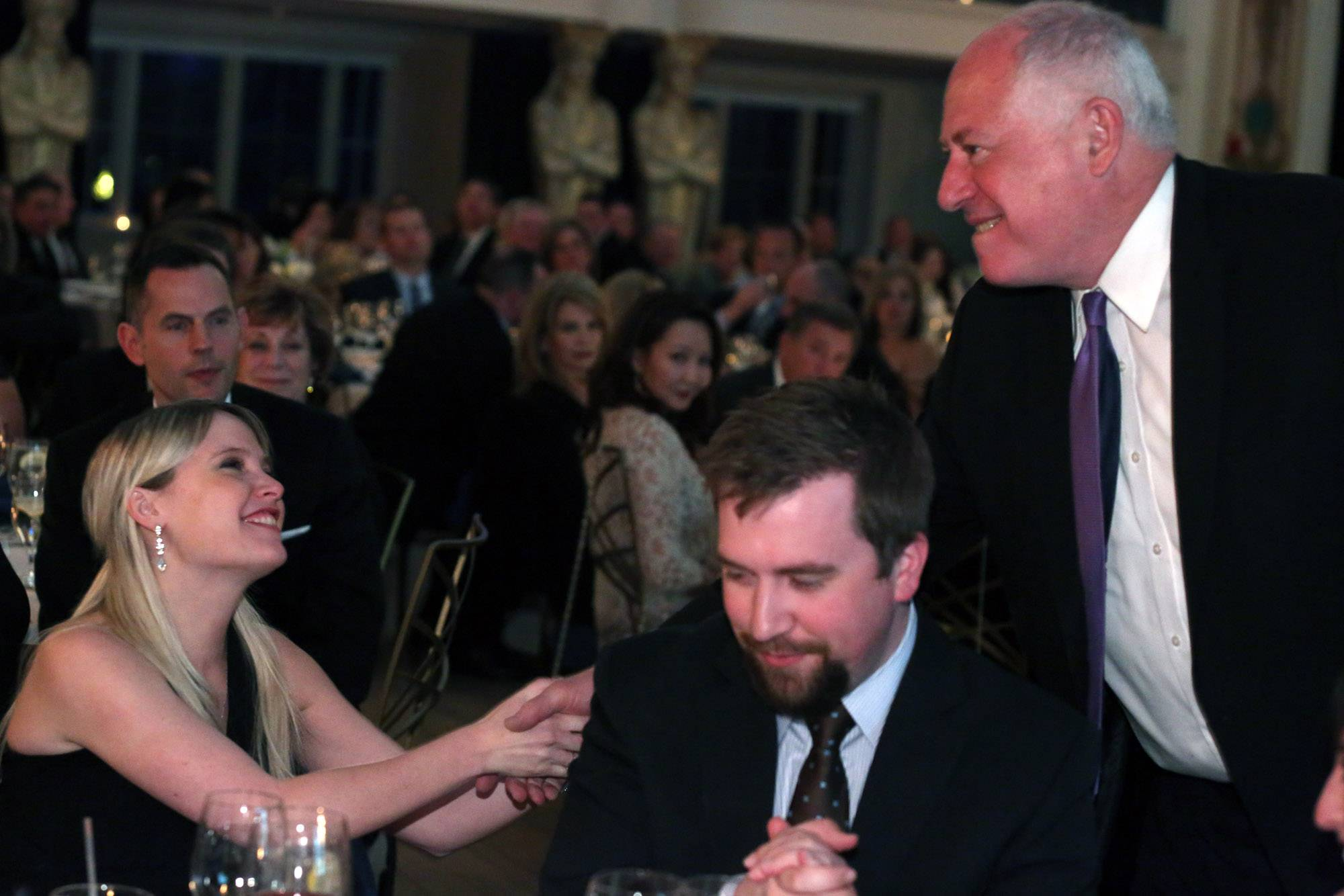 Gov. Pat Quinn congratulates Erin Merryn, who received the first Champion of Children award during the Children's Advocacy Center's inaugural Healing Hearts gala Saturday at Medinah Country Club Saturday. Also seated is Merryn's husband, David.
