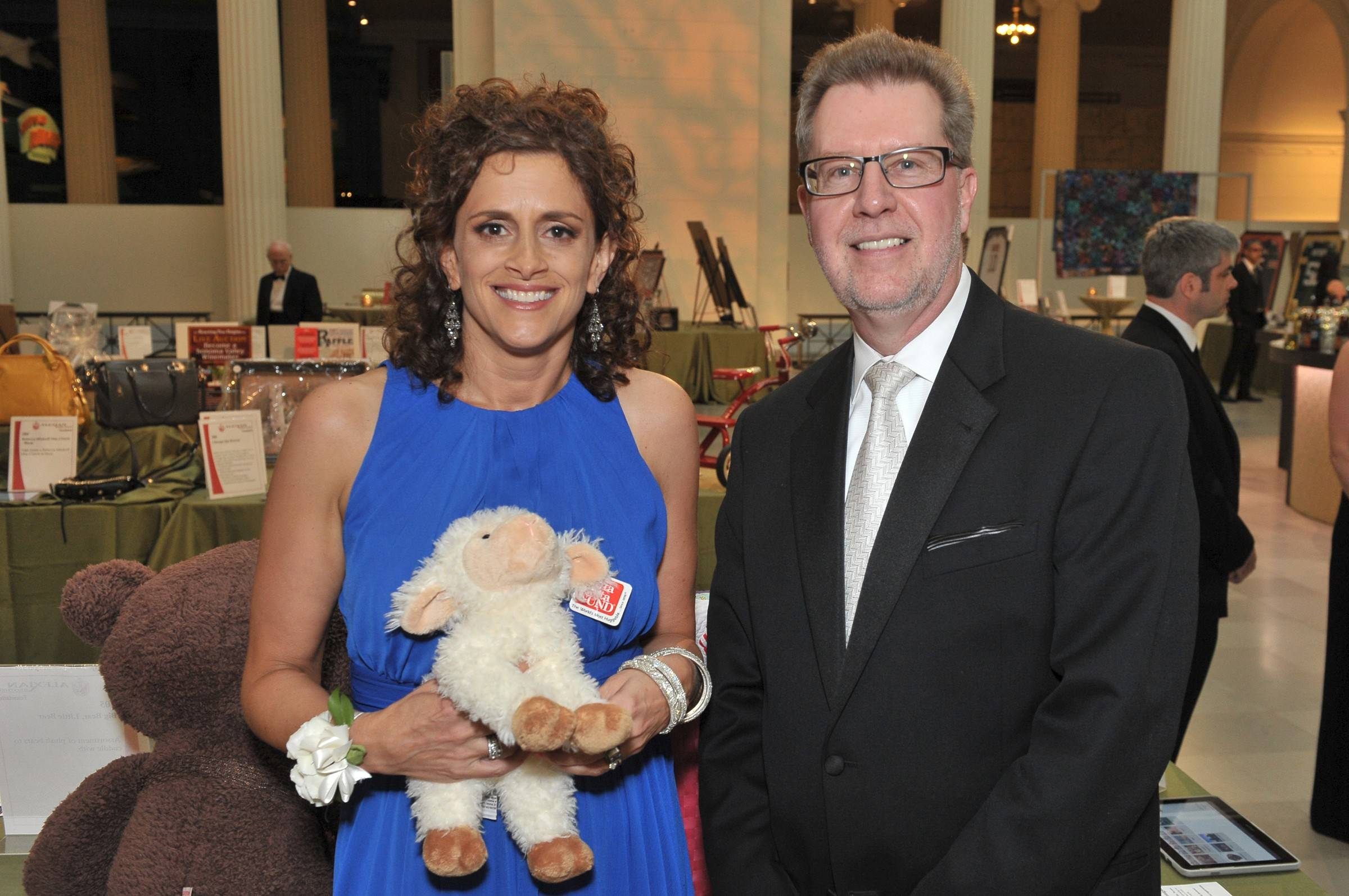 Melanie Furlan and Mark Frey, president and CEO of Alexian Brothers Health System, at the silent auction during the 28th Annual Alexian Brothers Ball de Fleur.