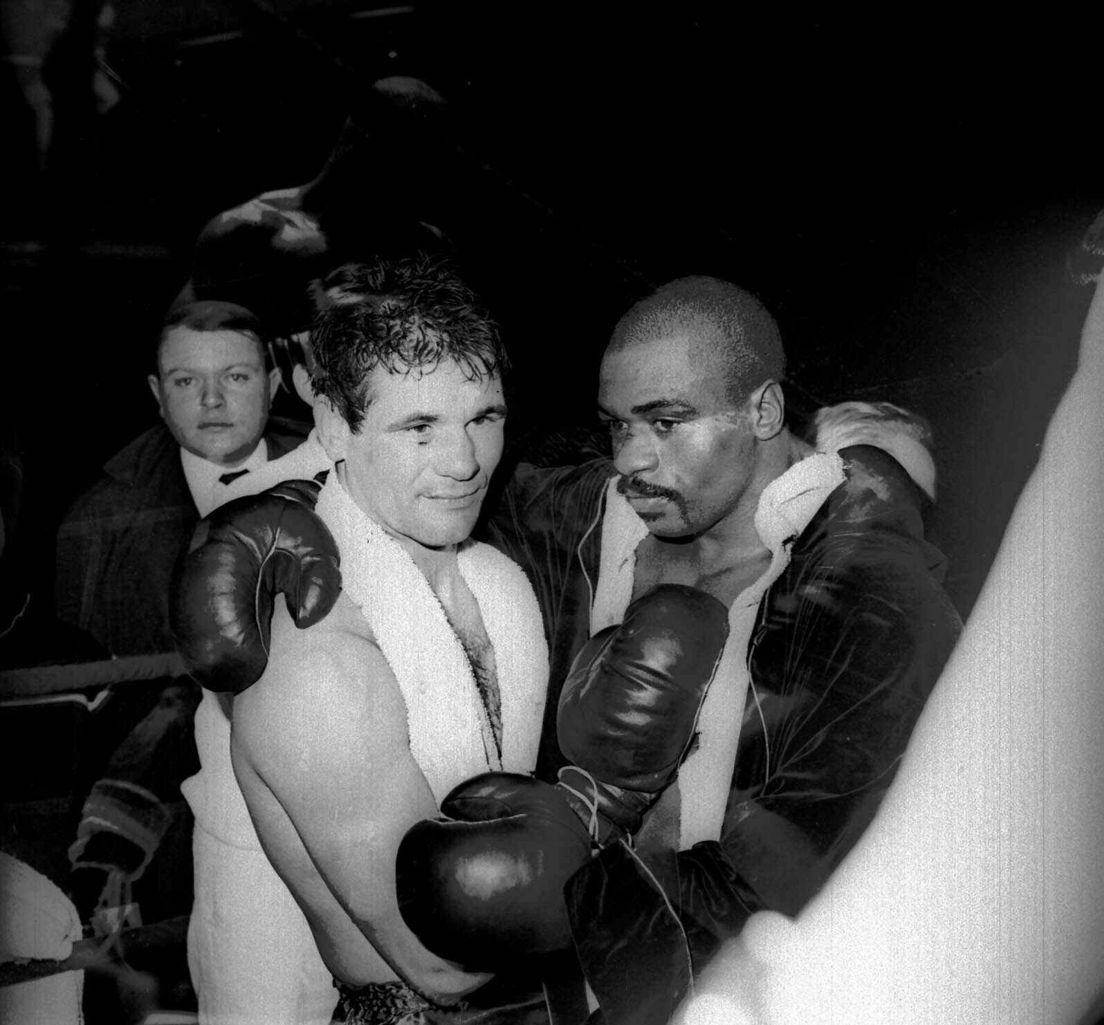 "In this Feb. 23, 1965, file photo, Rubin ""Hurricane"" Carter and Italian boxer Fabio Bettini pose after a fight at the Palais des Sports in Paris."