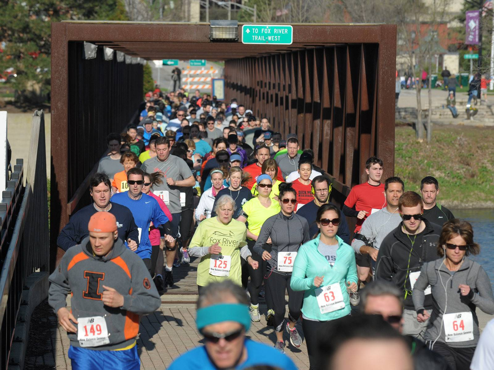 Runners take off across the Fox River on the pedestrian bridge for the Batavia Mothers' Club Foundation's 14th annual Fox Trot 5K/10K Saturday. This is the first year for the 10K.