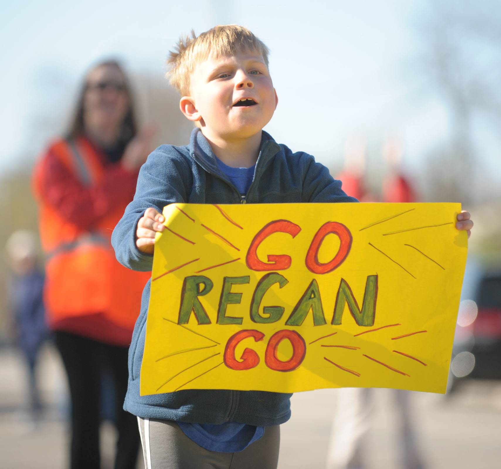 Ray Recklaus, 6, of Batavia cheers on his sister, Regan, 9, as she nears the finish line in the Batavia Mothers' Club Foundation's 14th annual Fox Trot 5K Saturday. A 10K was added to the event for the first time.