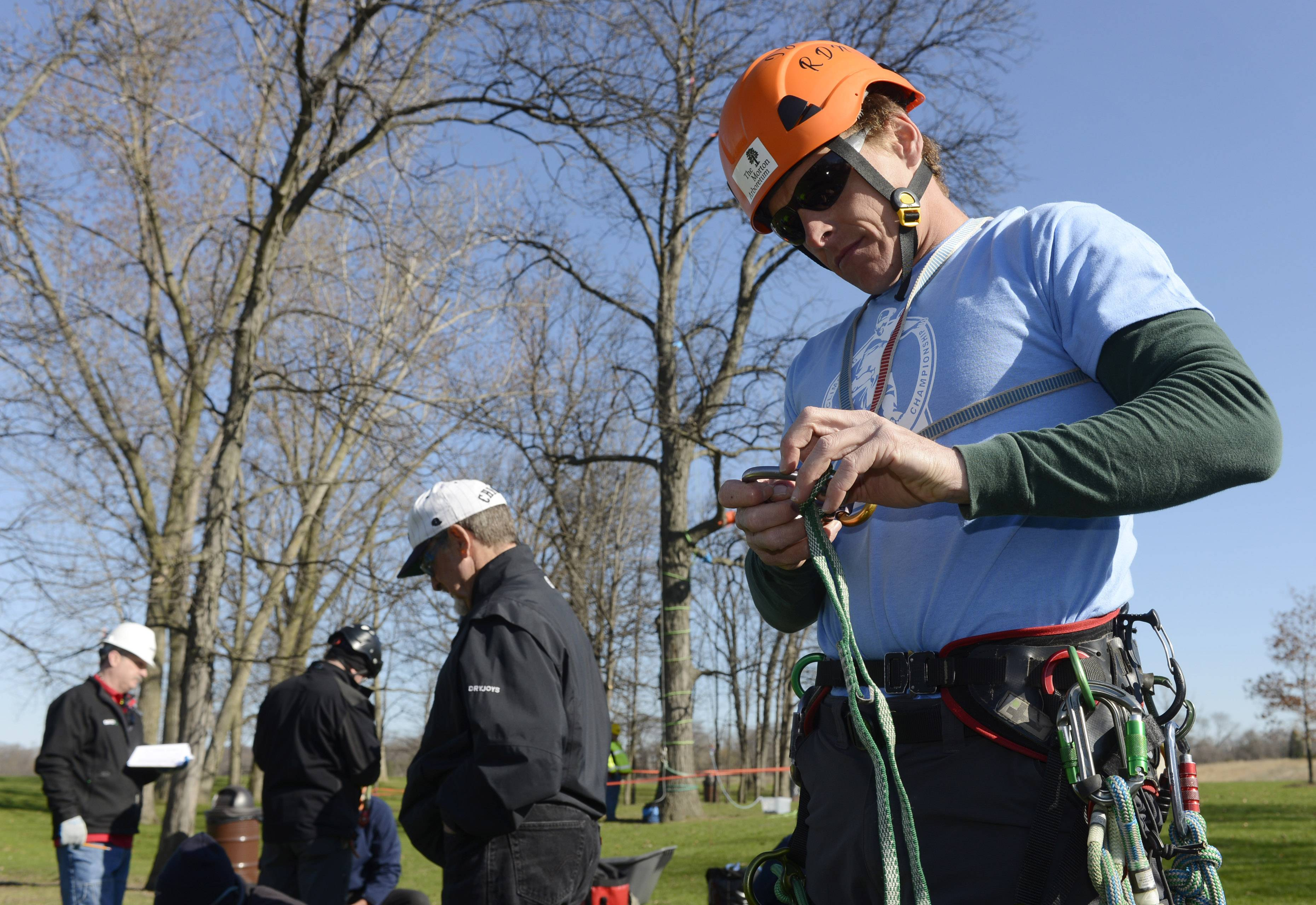 Beau Nagan, who works at the Morton Arboretum in Lisle, gets his equipment ready Saturday during the Illinois Arborist Tree Climbing Championship, held at Independence Grove near Libertyville.
