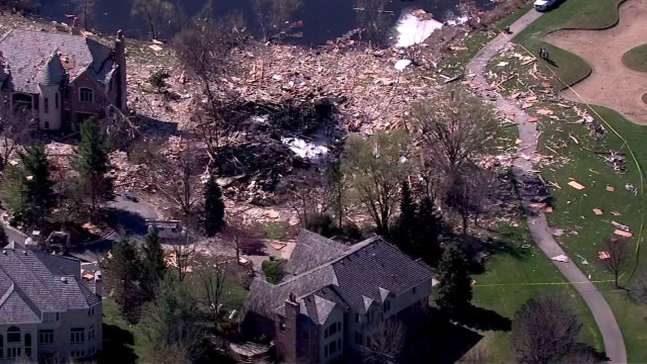 An aerial view shows the rubble and ashes that are all that's left of a Long Grove house that exploded Friday night. Debris that flew everywhere in the neighborhood also damaged the three surrounding houses.