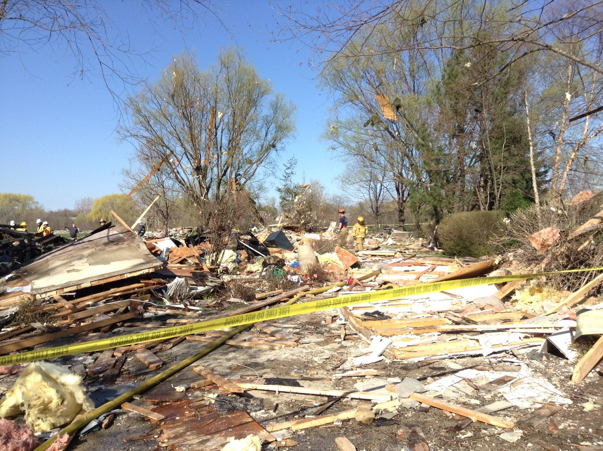 Countryside Fire Protection District officials said a woman just escaped from her home that exploded late Friday in Long Grove. Authorities and cleanup crews were around the debris Saturday. Officials said a preliminary investigation shows the blast was sparked by a natural gas leak.