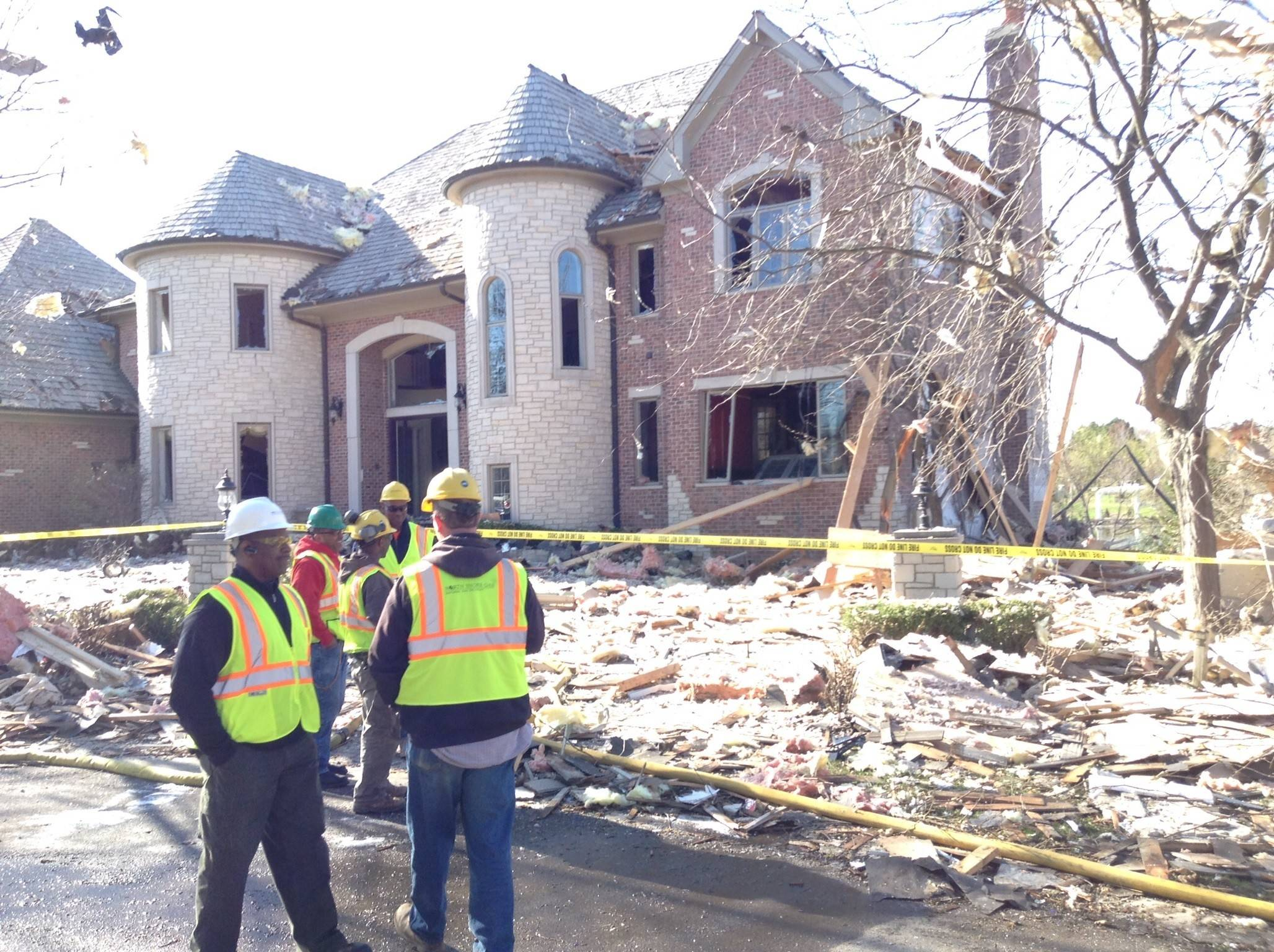 Crews of all kinds were on Trenton Court in Long Grove's Royal Melbourne subdivision Saturday handling the aftermath of a house explosion authorities believe was sparked by natural gas. This house is next to the one that was leveled by the explosion. No serious injuries were reported.